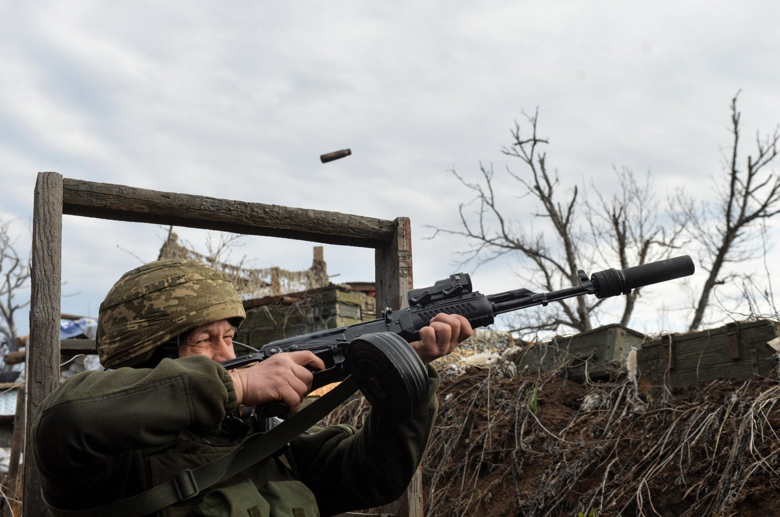 A service member of the Ukrainian armed forces fires in an attempt to shoot down an alleged unmanned aerial vehicle (UAV) at fighting positions on the line of separation from pro-Russian rebels near Donetsk, Ukraine, April 11, 2021. (Reuters Photo)