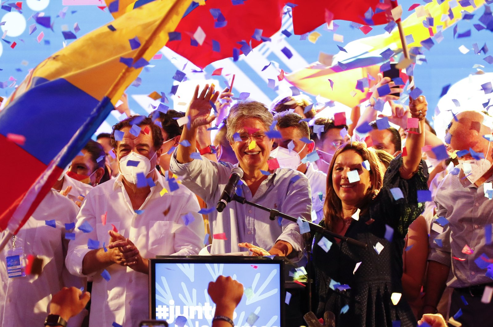 Guillermo Lasso (C), presidential candidate of Creating Opportunities party, (CREO) celebrates after a presidential runoff election at his campaign headquarters in Guayaquil, Ecuador, April 11, 2021. (AP Photo)