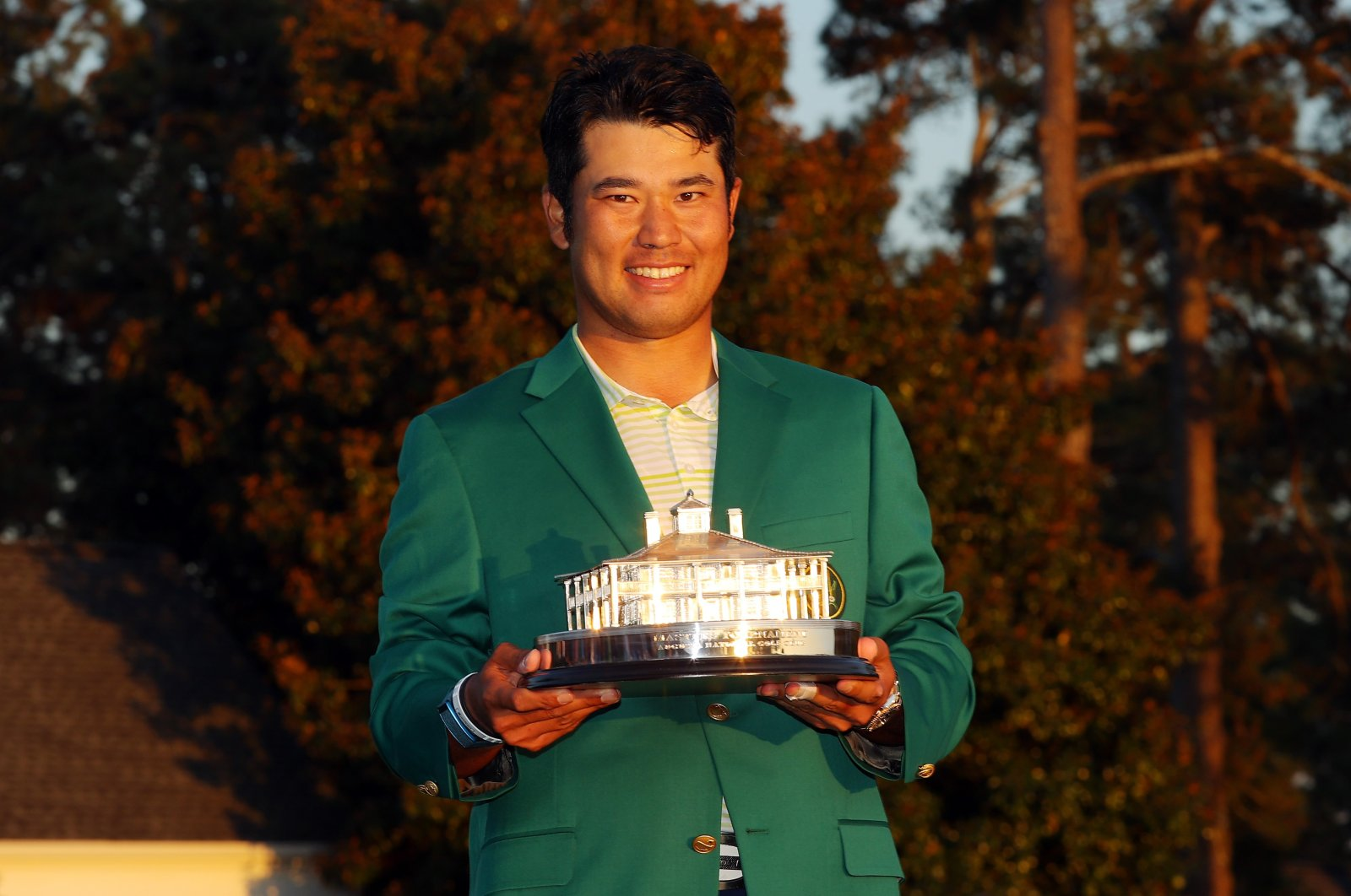 Japan's Hideki Matsuyama poses with the Masters Trophy at Augusta National Golf Club, Augusta, Georgia, April 11, 2021. (AFP Photo)