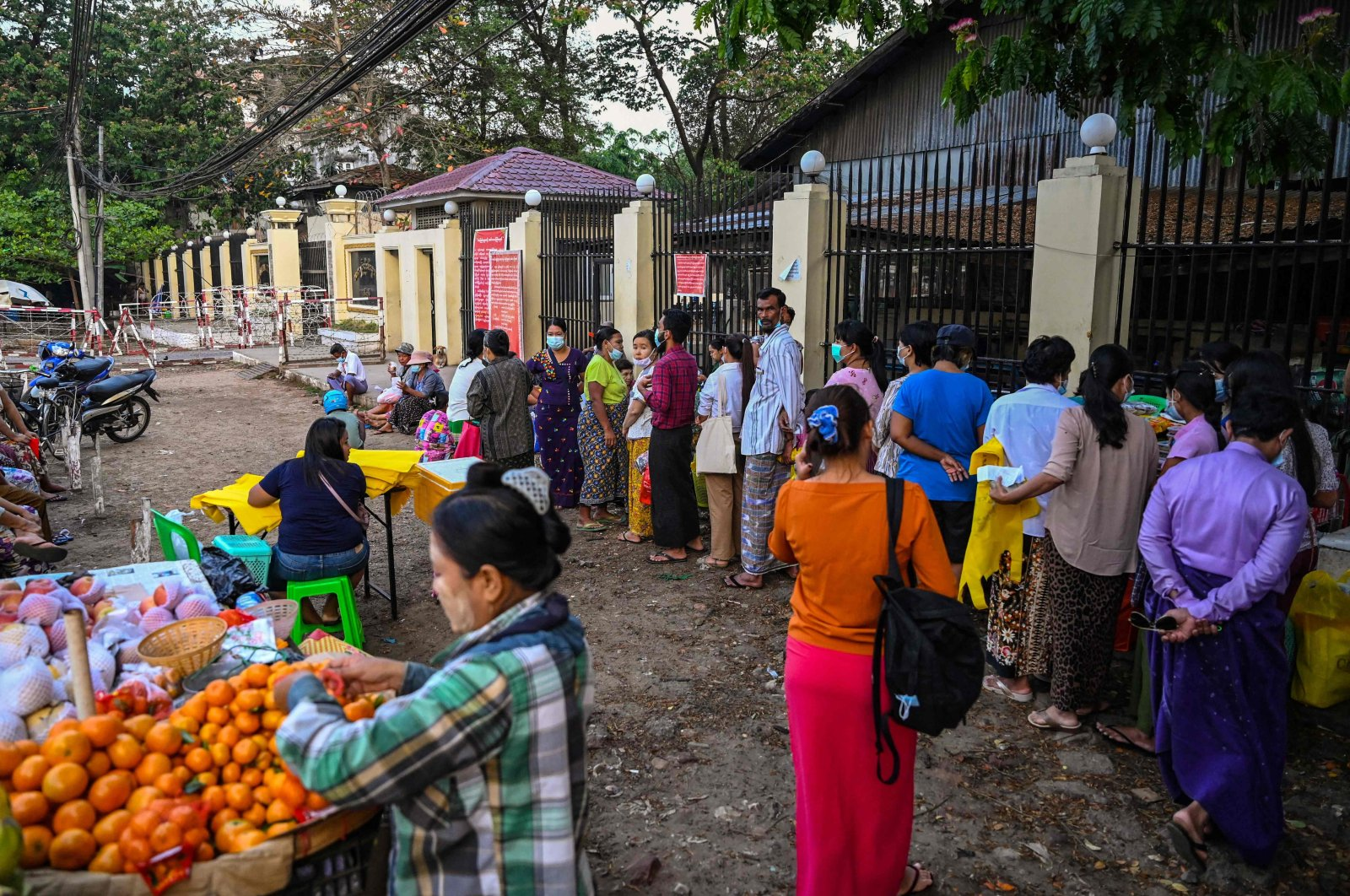 People queue in front of Insein Prison in Yangon while they wait to visit inmates ahead of the long holiday stretch for the Myanmar New Year, also known as Thingyan, as the country remains in turmoil after the February military coup, Yangon, Myanmar, April 12, 2021. (AFP Photo)