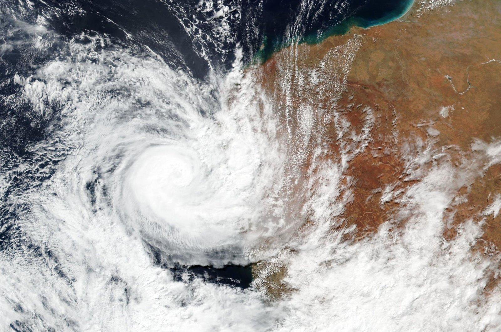 A satellite image shows Tropical Cyclone Seroja hitting the coast of Western Australia, April 11, 2021. (NASA via AP)