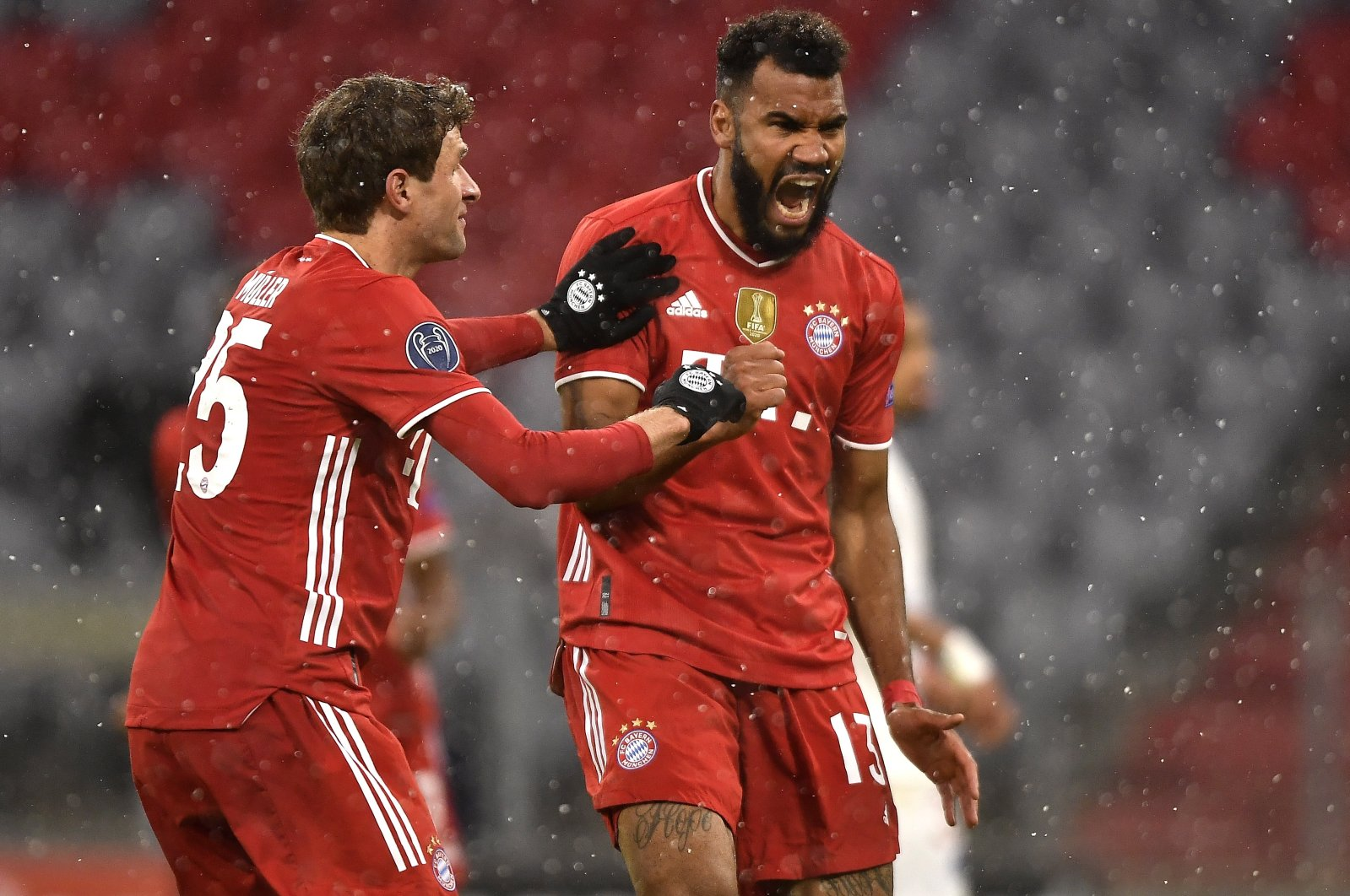 Bayern Munich's Eric Maxim Choupo-Moting (R) celebrates with teammate Thomas Mueller after scoring a goal against PSG in the UEFA Champions League quarterfinal first leg tie, Munich, Germany, April 7, 2021. (EPA Photo)