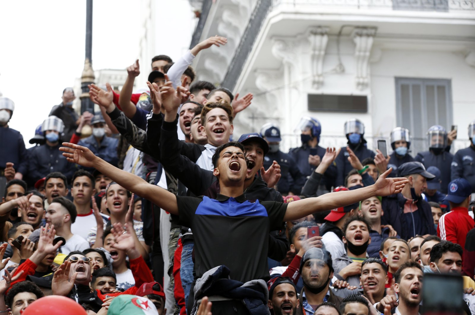 Algerians shout slogans during anti-government demonstration in Algiers, Algeria, Feb. 26, 2021. (Photo by Getty Images)