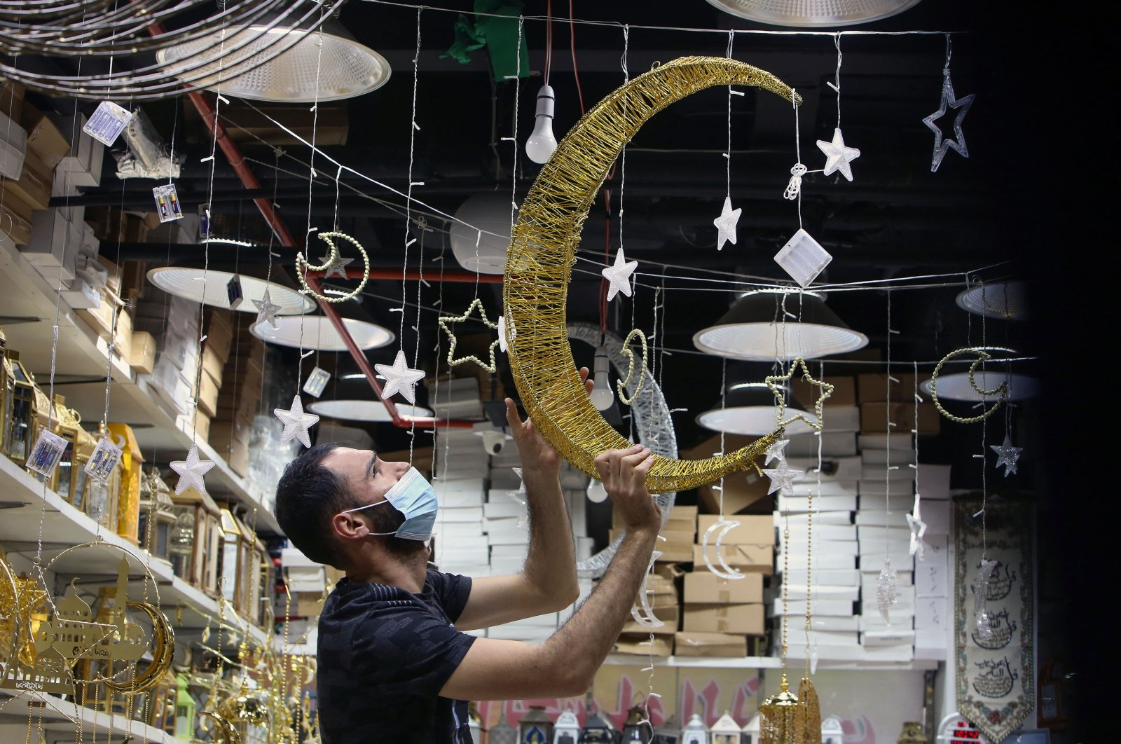 A vendor decorates his shop at a market a day before the start of the holy month of Ramadan in Kuwait City, Kuwait, April 12, 2021. (AFP Photo)