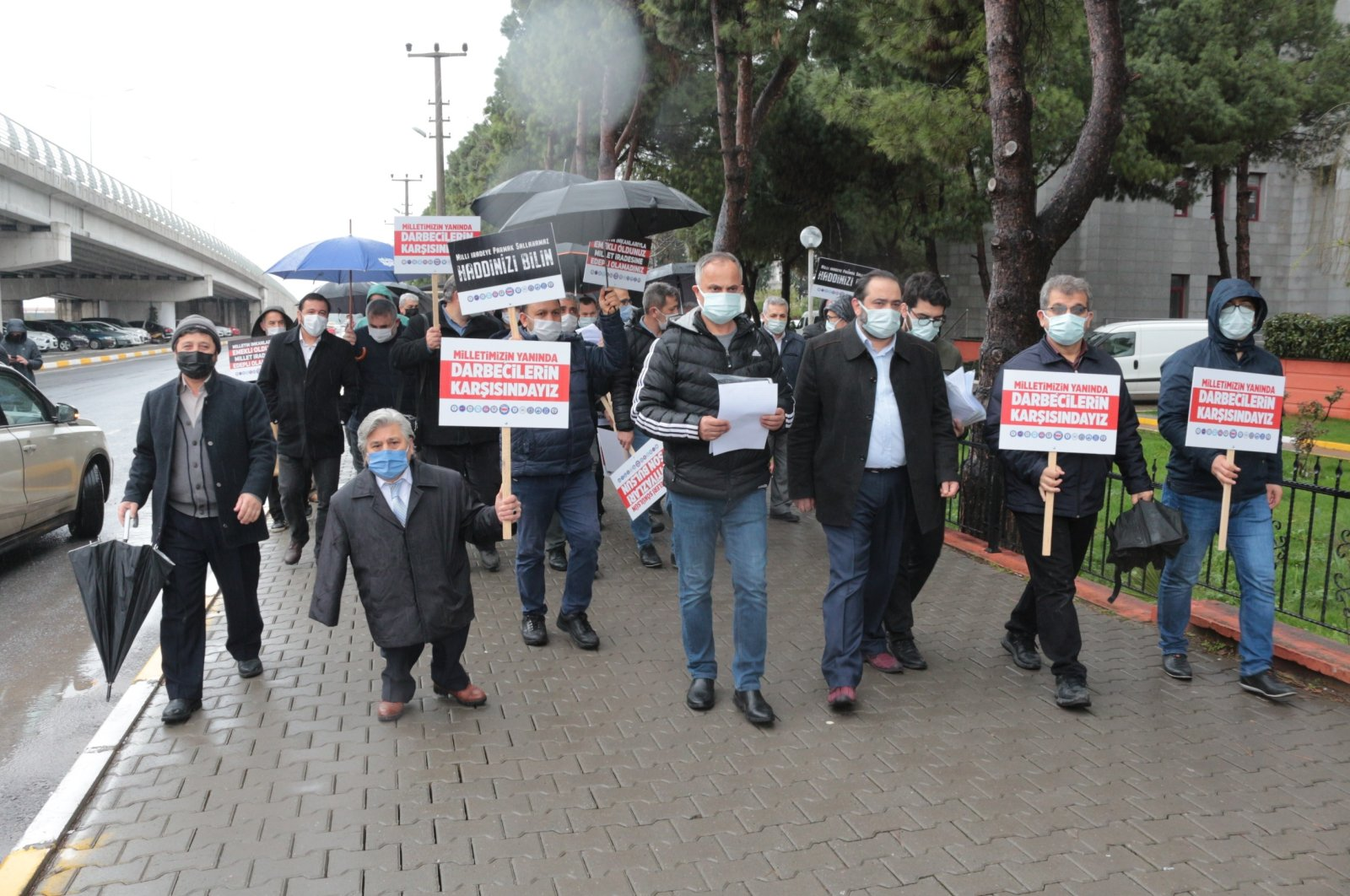 People march in protest of the declaration signed by retired admirals, western Balıkesir province, Turkey, Apr. 5, 2021. (İHA Photo)