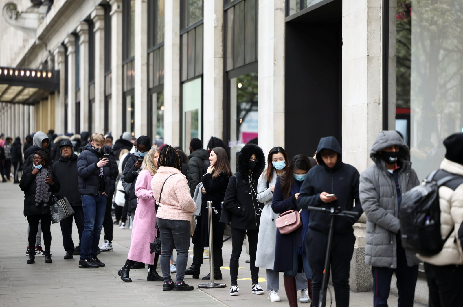 People queue outside a shop on Oxford street, as COVID-19 restrictions ease, in London, Britain, April 12, 2021. (Reuters Photo)