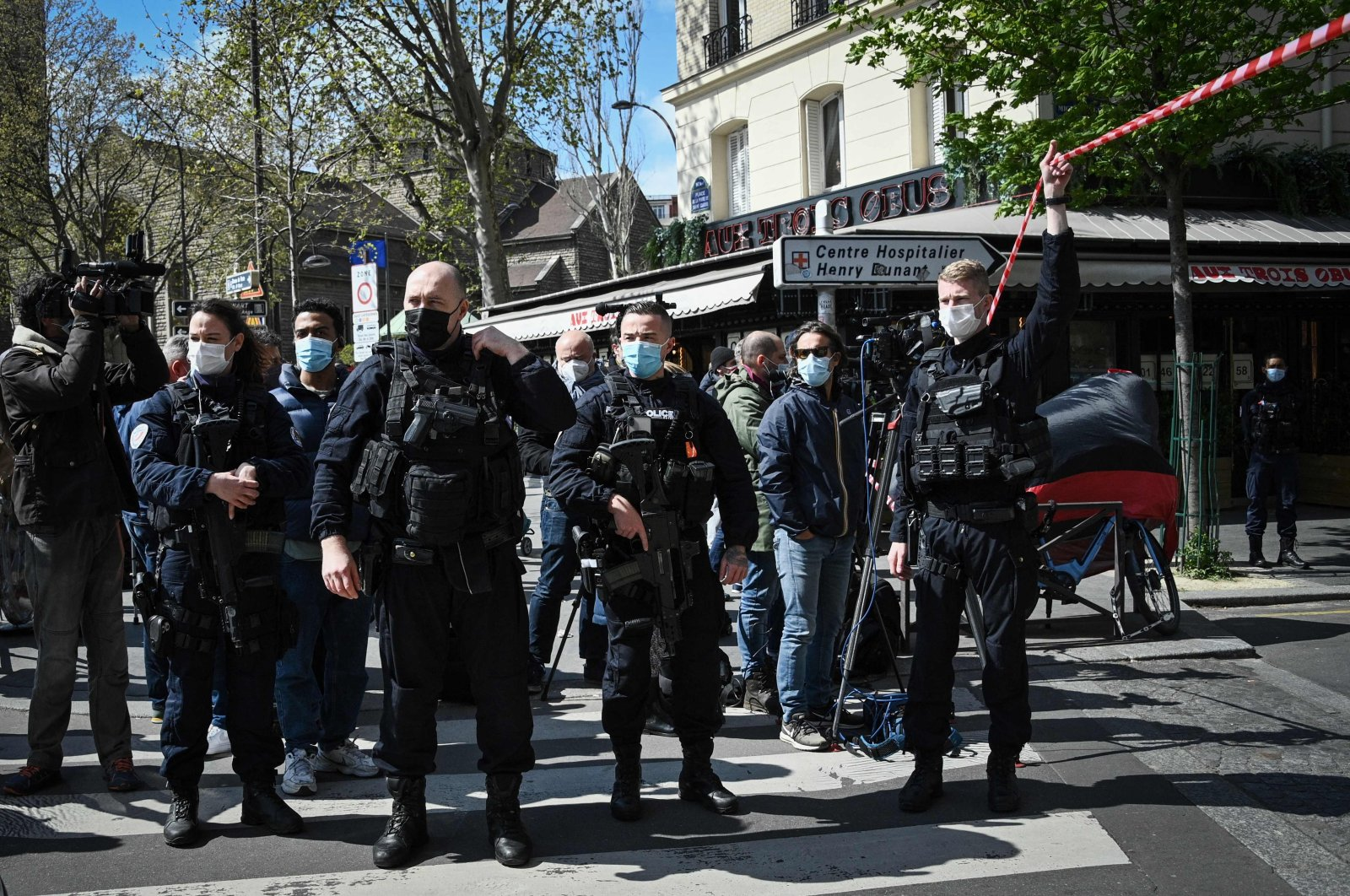 French police cordon off the area near the Henry Dunant private hospital where one person was killed and another injured in a shooting outside the institution owned by the Red Cross in Paris' upmarket 16th district, Paris, France, April 12, 2021. (AFP Photo)