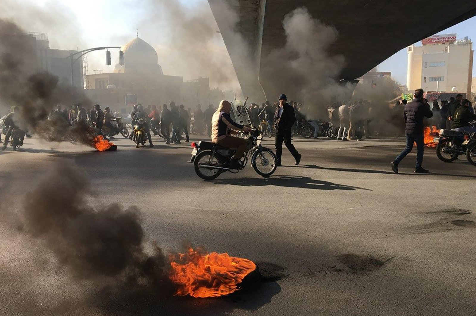 Iranian protesters rally amid burning tires during a demonstration against an increase in gasoline prices, in the central city of Isfahan, Iran, Nov. 16, 2019. (AFP Photo)