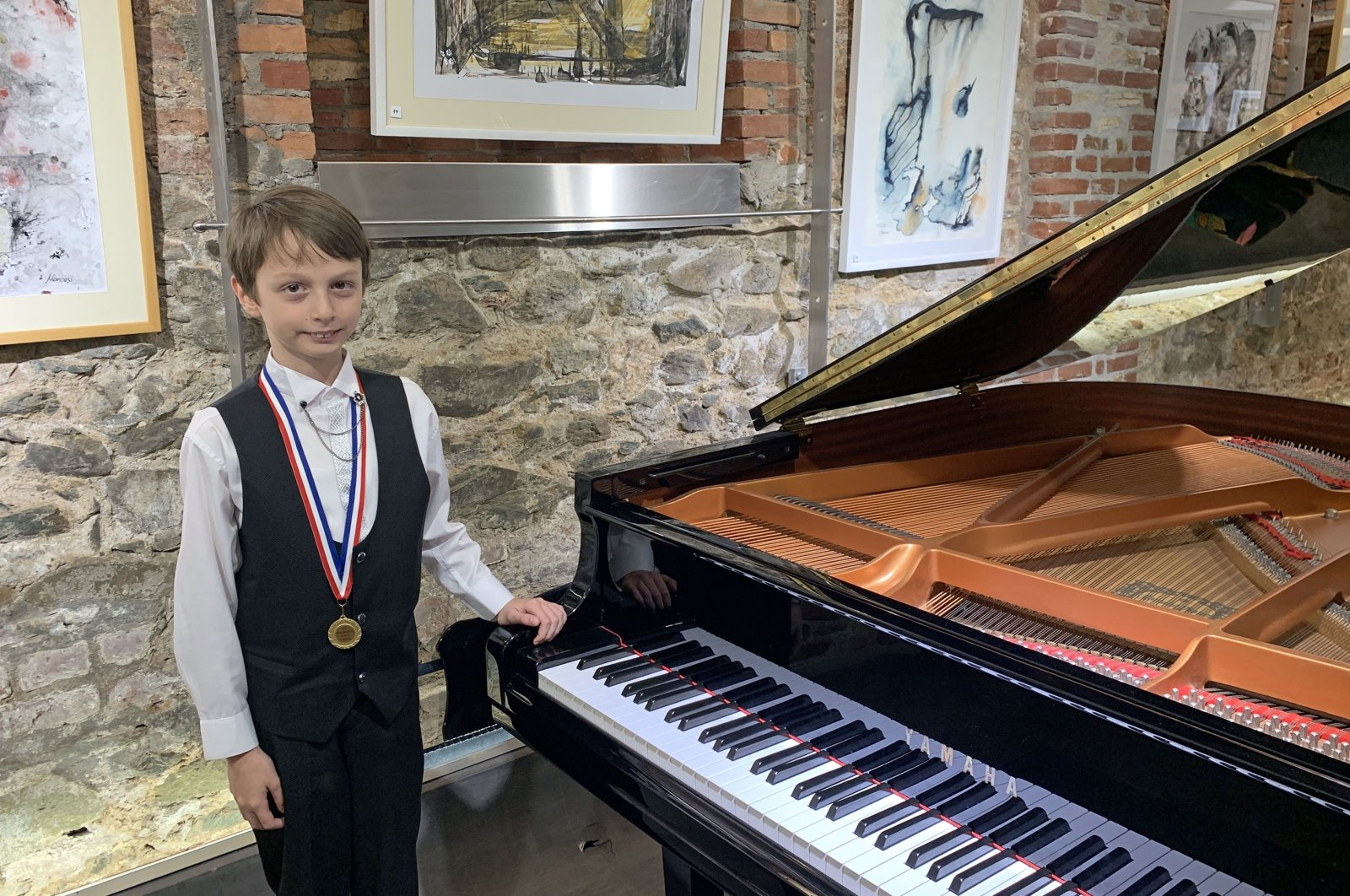 İrfan Karakılıç poses near his piano. (AA Photo)