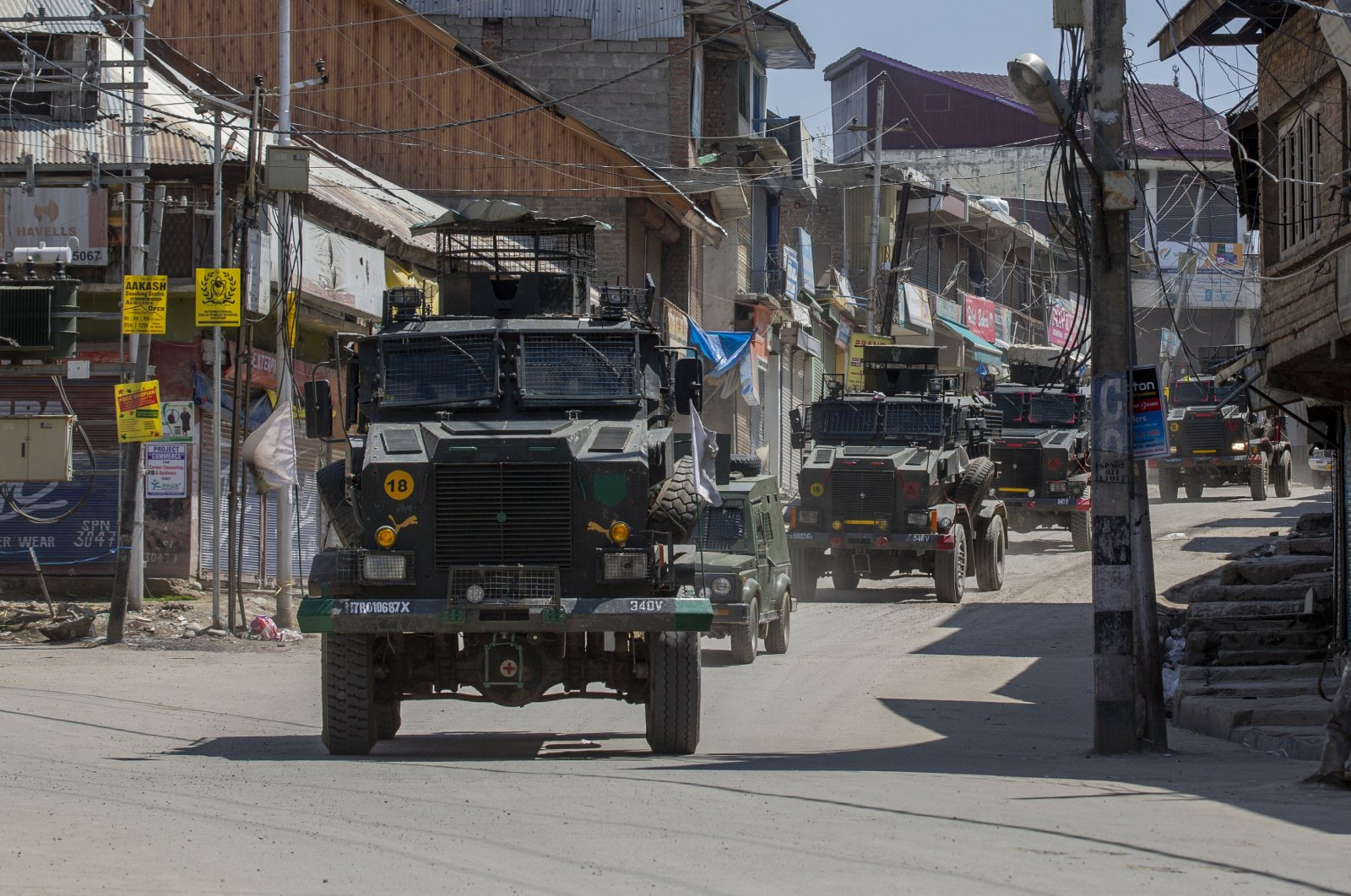 Indian army vehicles leave after a gunbattle in Shopian, south of Srinagar, Indian controlled Kashmir, April 9, 2021. (AP Photo)