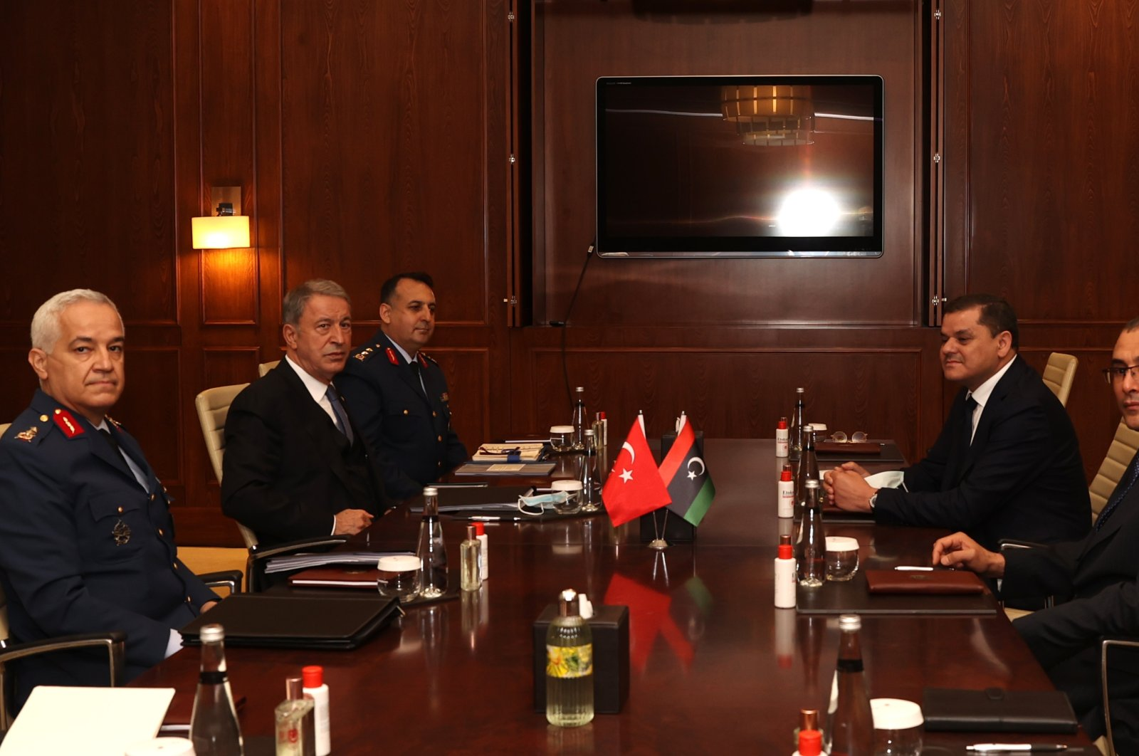 Defense Minister Hulusi Akar (C-L) holds a meeting with Libyan Prime Minister Abdul Hamid Dbeibah (C-R) in Ankara, April 12, 2021. (AA Photo)