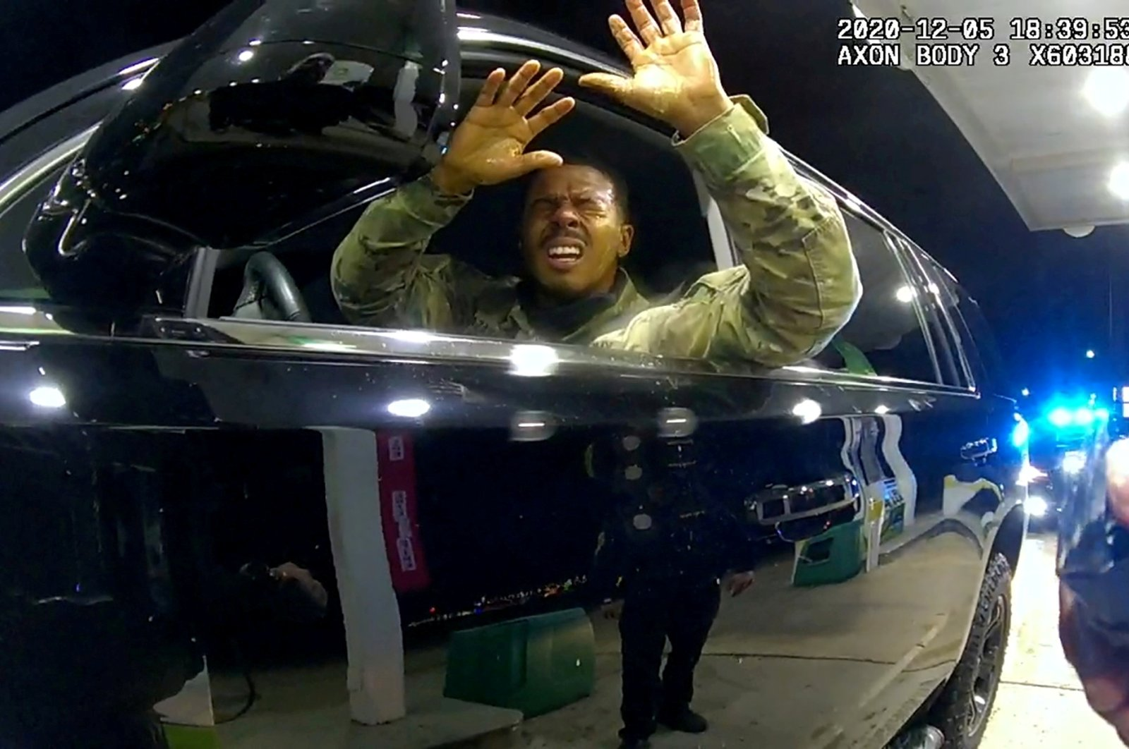 U.S. Army 2nd Lieutenant Caron Nazario reacts as he holds up his hands after being sprayed with a chemical agent by Windsor police officer Joe Gutierrez during a violent traffic stop at a gas station in a still image from Gutierrez's body camera taken in Windsor, Virginia, the U.S., Dec. 5, 2020. (REUTERS Photo)