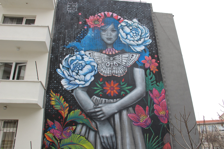 The 'Blossom' mural by Mexican artist Kathrina Rupit on a building on Güvenlik Street in the Çankaya district of Ankara, Turkey, April 13, 2021. (İHA Photo)