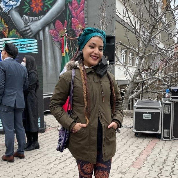 Mexican artist Kathrina Rupit poses in front of her 'Blossom' mural, in Ankara, Turkey, April 13, 2021. (AA Photo)