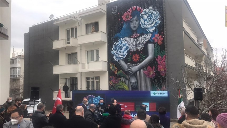 """People attend the introduction of """"Blossom"""" by Mexican artist Kathrina Rupit on Güvenlik Street in the Çankaya district of Ankara, Turkey, April 13, 2021. (AA Photo)"""