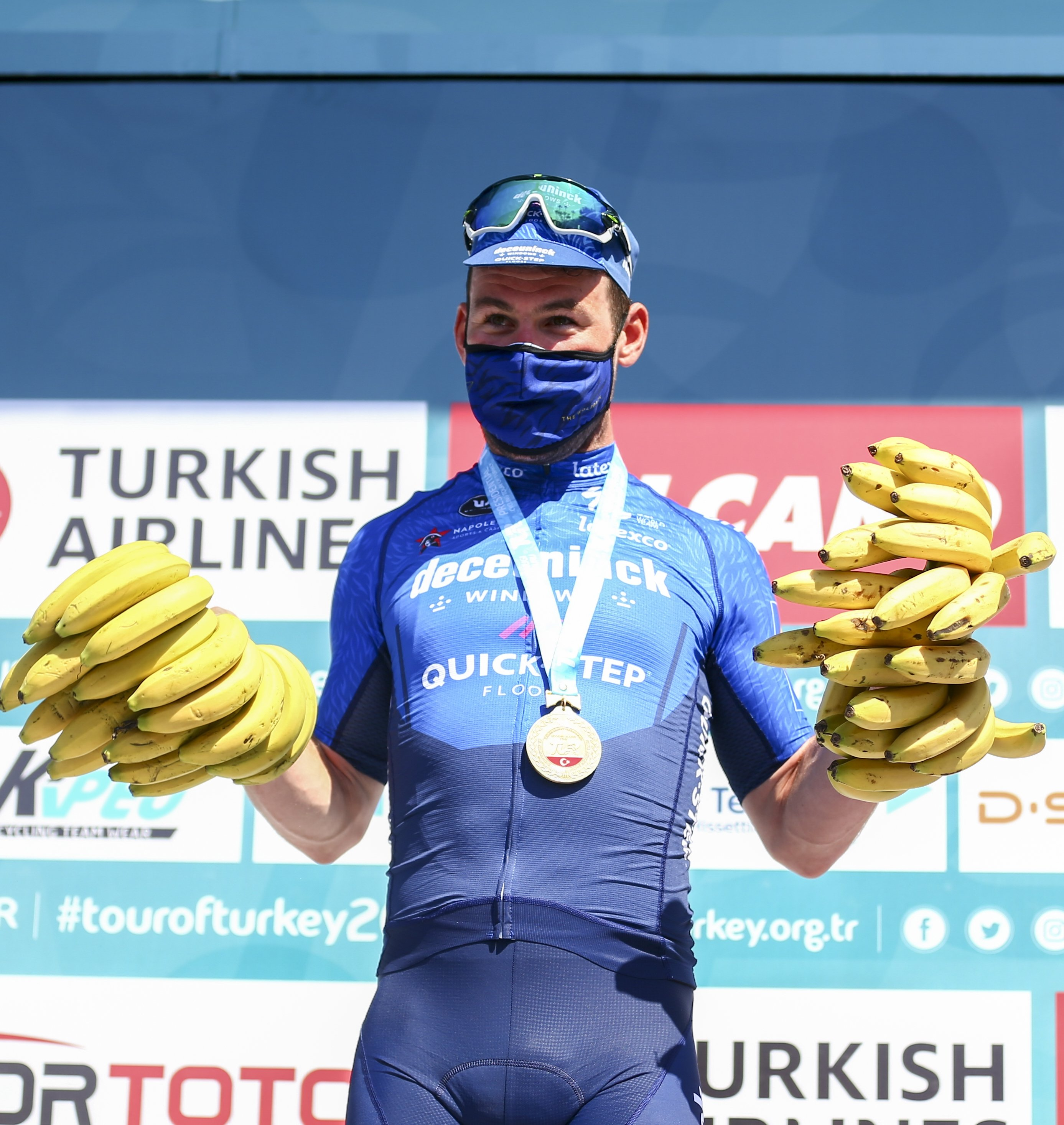 Deceuninck-Quick Step's British sprinter Mark Cavendish pose with locally-grown bananas after the 3rd stage of Presidential Cycling Tour of Turkey, in Alanya, southern Turkey, April 13, 2021. (AA Photo)