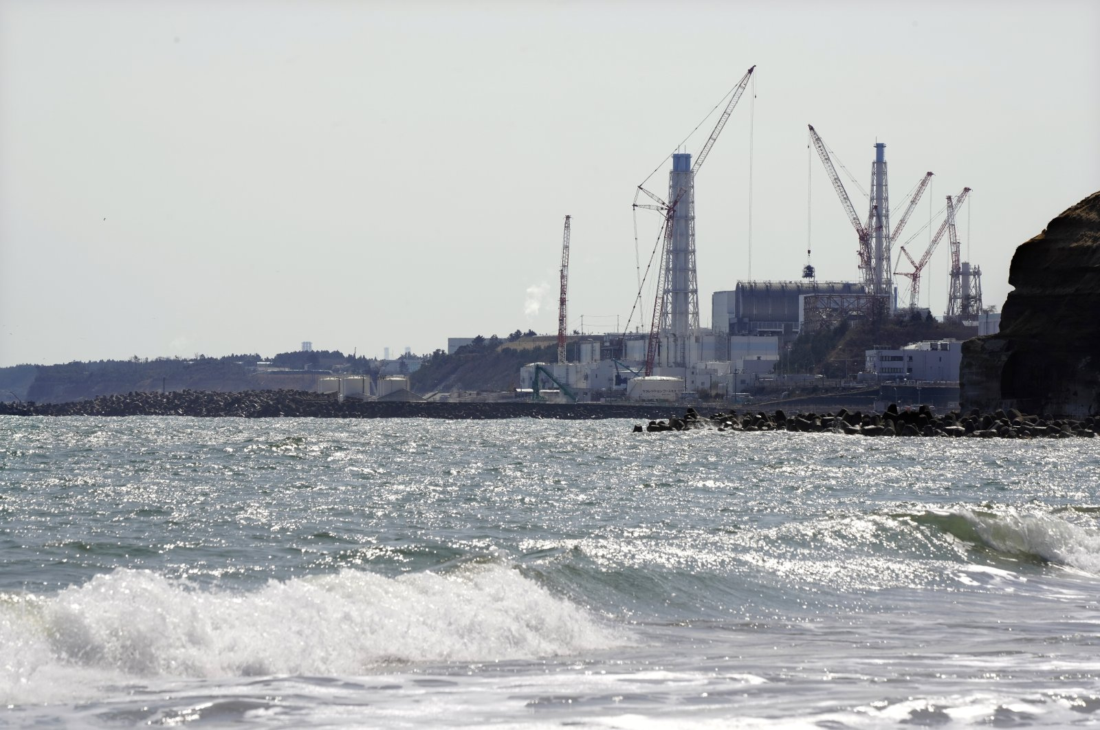 A view of Tokyo Electrical Power Company's (TEPCO) Fukushima Daiichi Nuclear Power Plant undergoing decommissioning work, as seen from Namie, Fukushima Prefecture, northern Japan, March 11, 2021. (EPA Photo)