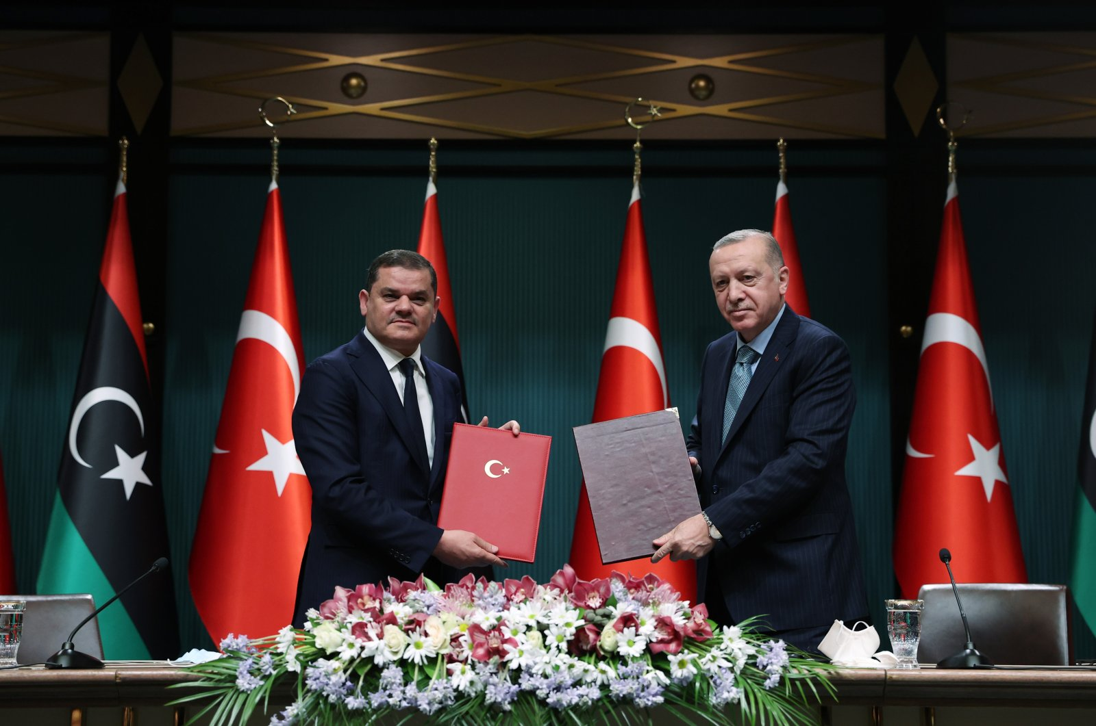 Libya's Prime Minister Abdul Hamid Mohammed Dbeibah (L) and President Recep Tayyip Erdoğan pose for a photo during a signing ceremony after their meeting in the capital Ankara, Turkey, April 12, 2021. (AA Photo)