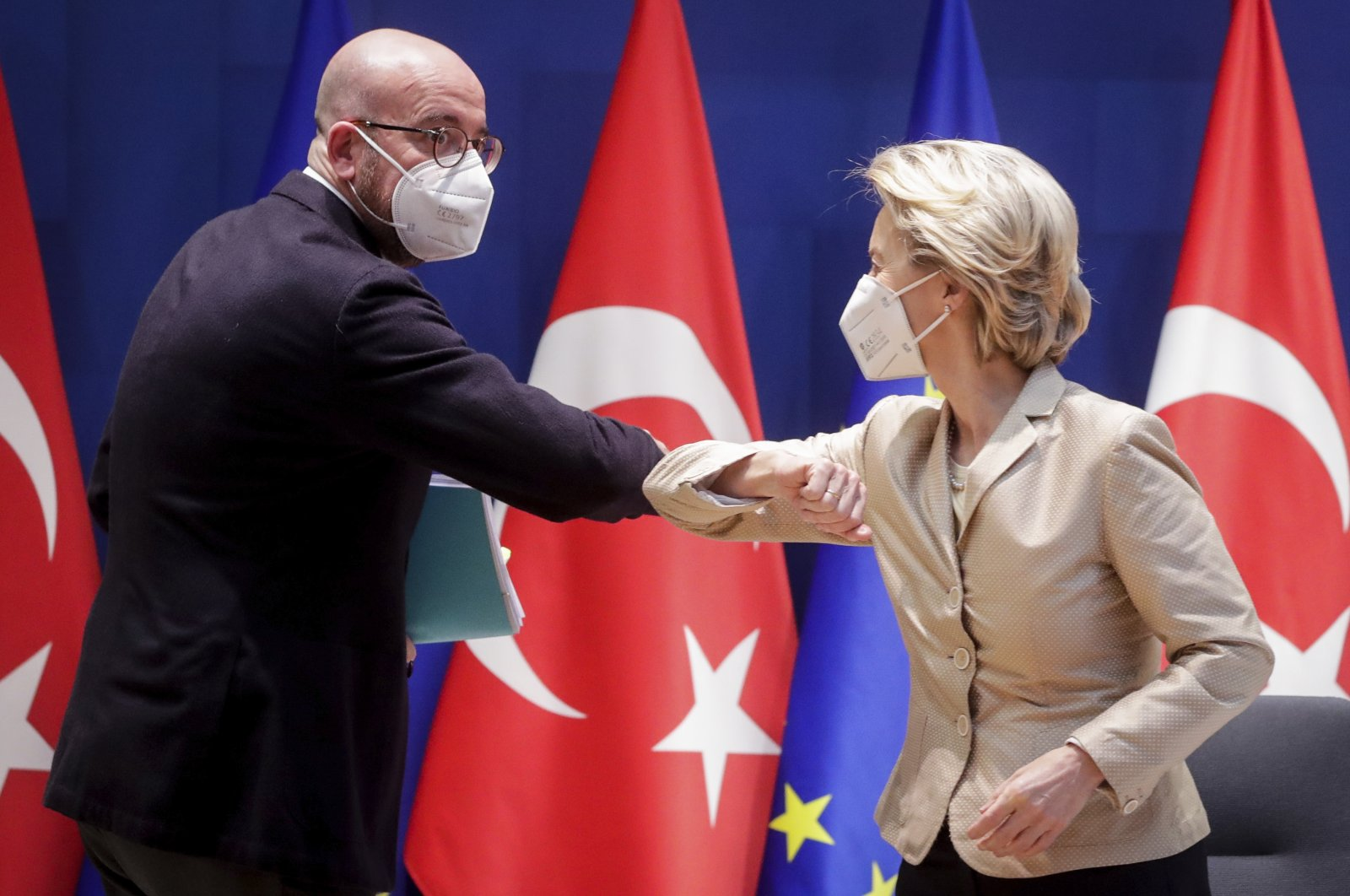 European Council President Charles Michel (L) greets European Commission President Ursula von der Leyen with an elbow bump prior to participating in a videoconference meeting with President Recep Tayyip Erdoğan (not pictured) at the European Council building, Brussels, Belgium, March 19, 2021. (AP Photo)