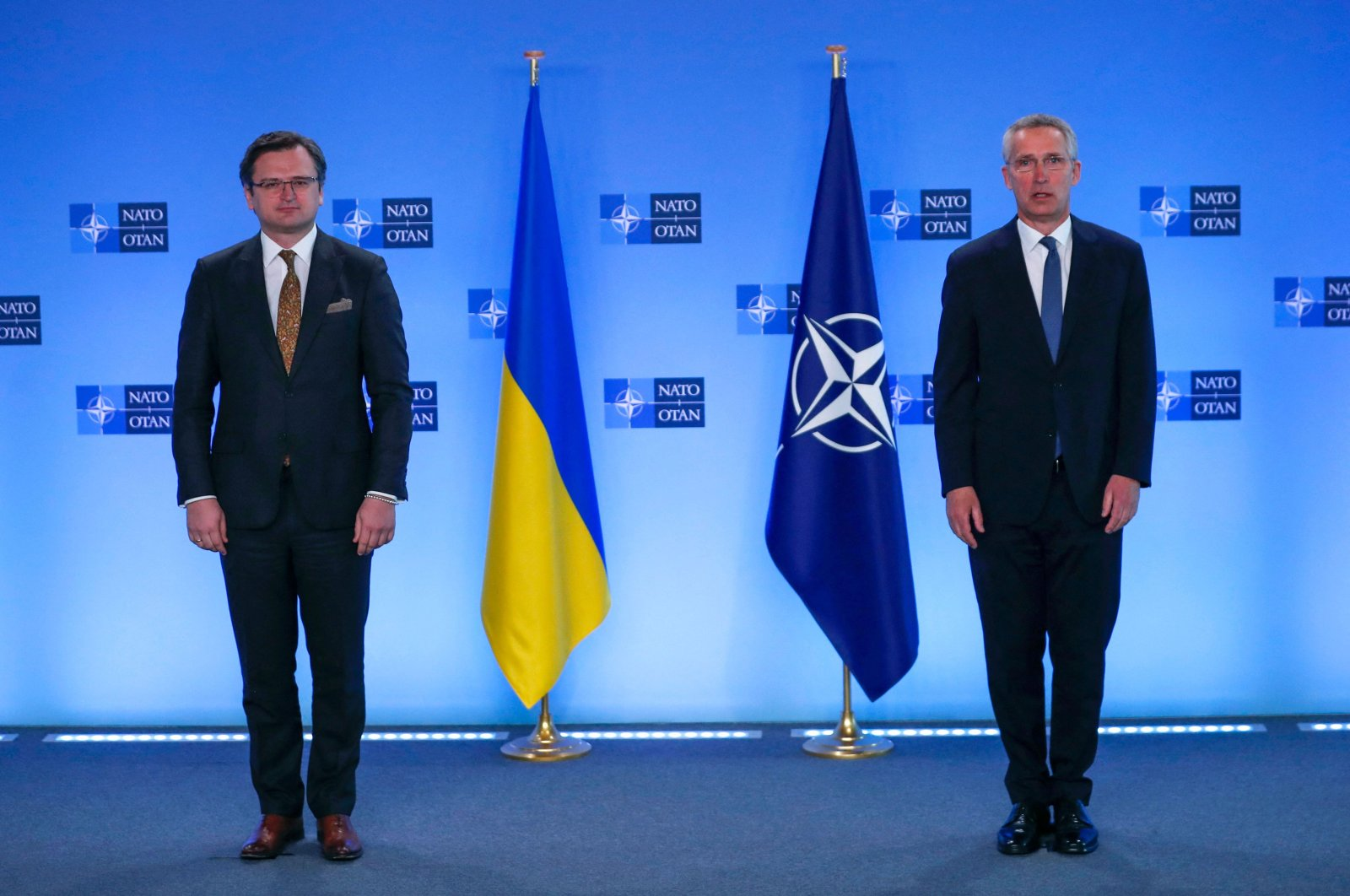 Ukraine's Foreign Minister Dmytro Kuleba (L) and NATO Secretary-General Jens Stoltenberg pose prior to their meeting at NATO headquarters in Brussels, on April 13, 2021. (AFP Photo)