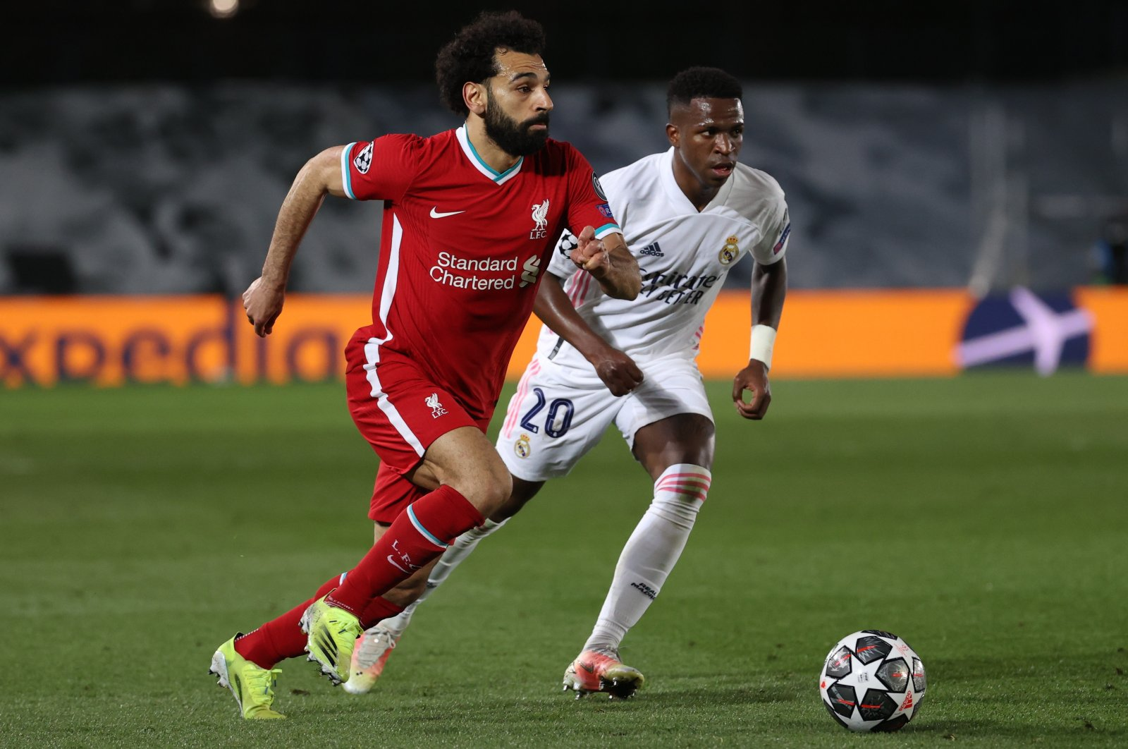 Liverpool striker Mohamed Salah (L) tries to go past Real Madrid's Vinicius Jr. during the UEFA Champions League quarterfinal first leg match at the Alfredo Di Stefano stadium, Madrid, Spain, April 6, 2021. (EPA Photo)