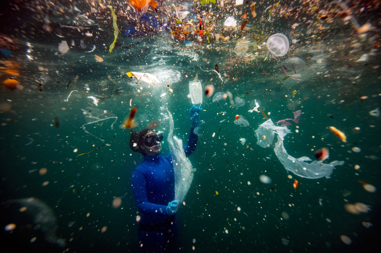 Şebnem Coşkun's photo of Turkish diver Şahika Ercümen among the plastic pollution in the Bosporus Strait won the Nature and Environment category at Pictures of the Year, Asia. (AA Photo)