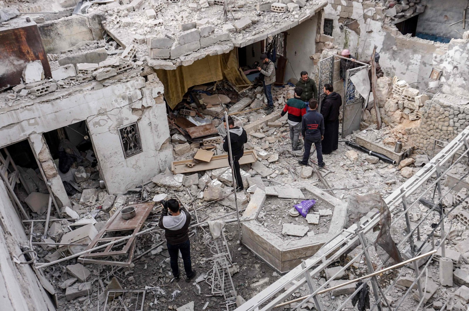 Syrians inspect damage from a reported regime airstrike at a civilian residence in the town of Saraqib in the northwestern Idlib province, Syria, March 10, 2019. (AFP Photo)