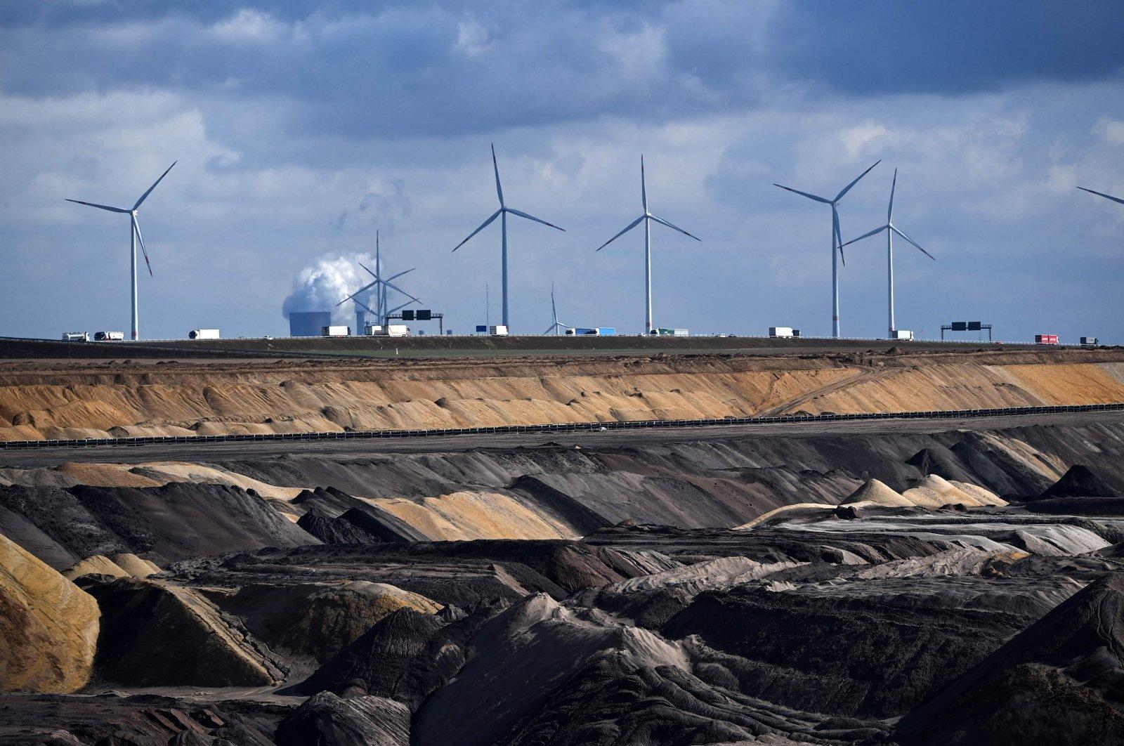 Wind turbines near the open-cast mining of German energy giant RWE in Garzweiler, western Germany, March 15, 2021. (AFP Photo)