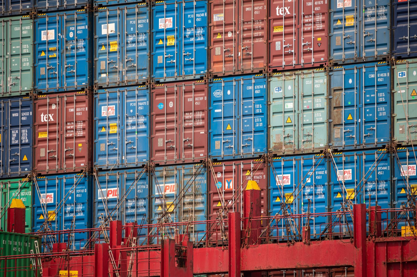Containers are stacked on a container ship in Kwai Tsing Terminals in Hong Kong, China, March 29, 2021. (EPA Photo)