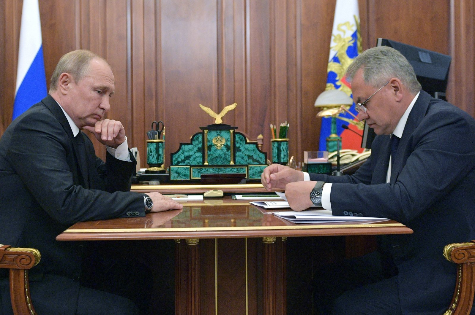 Russian President Vladimir Putin (L) listens to Russian Defense Minister Sergei Shoigu during their meeting in the Kremlin in Moscow, Russia, Tuesday, July 2, 2019. (AP Photo)