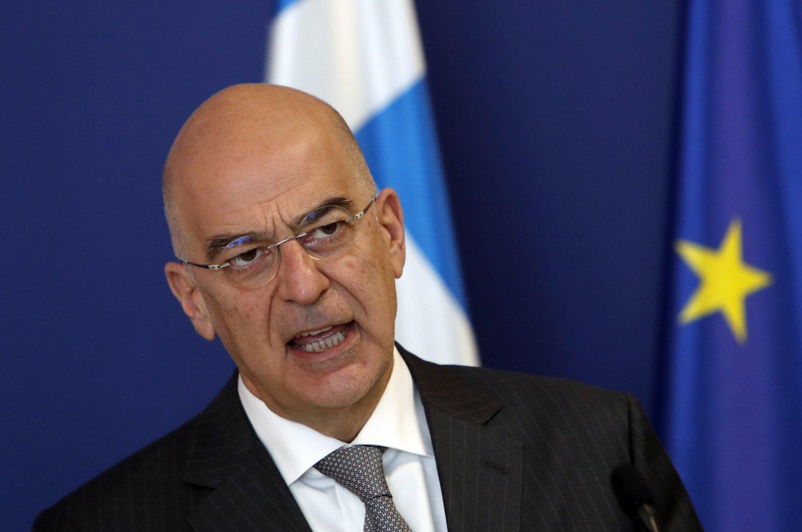Greek Foreign Minister Nikos Dendias speaks during a press conference in Belgrade, Serbia, April 5, 2021. (AP Photo)