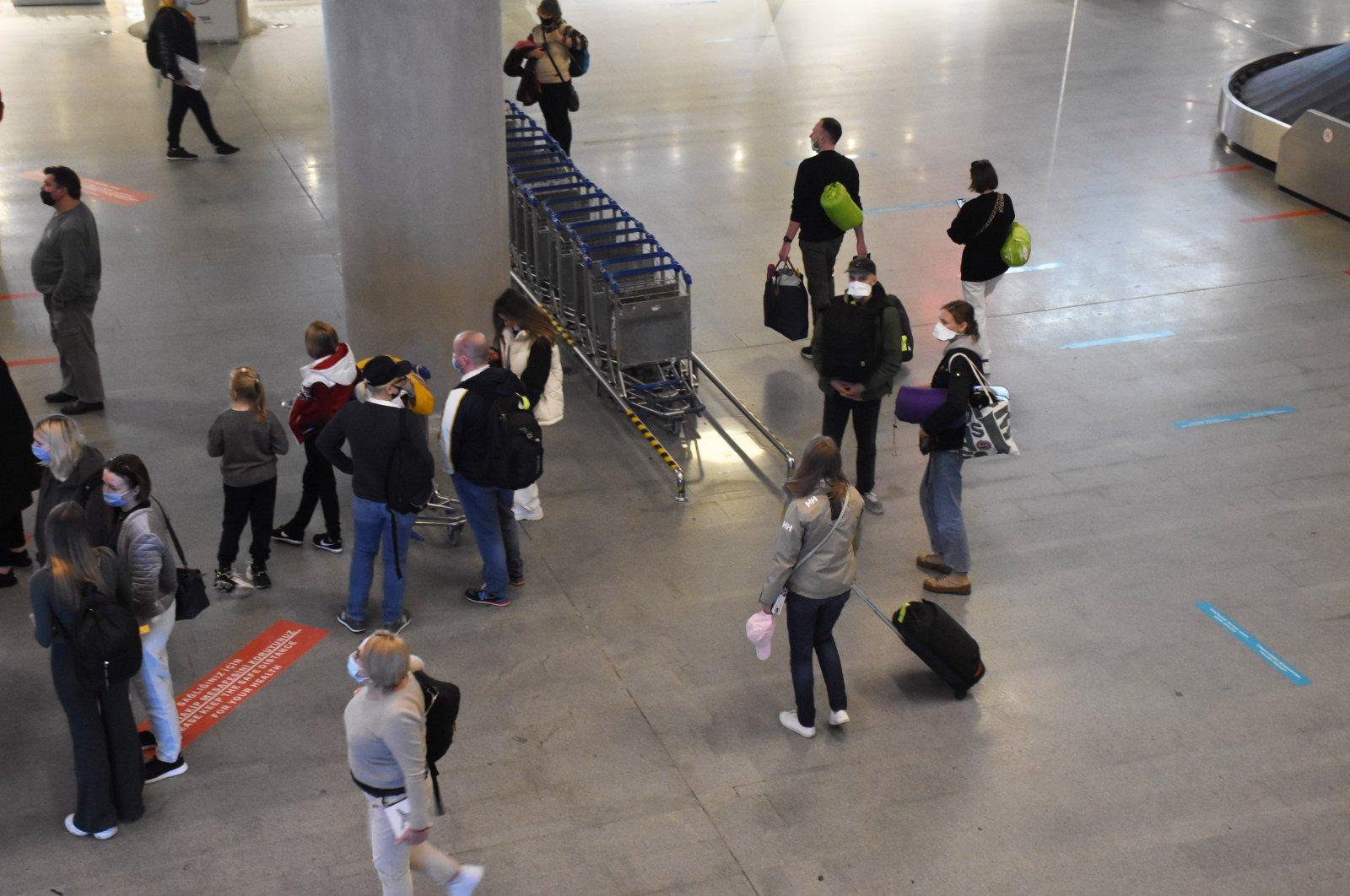 Russian tourists arrive at Dalaman Airport, Muğla, southwestern Turkey, March 19, 2021. (AA Photo)