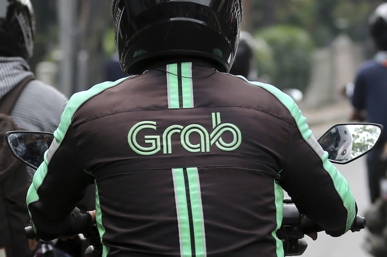 A GrabBike driver rides on his motorbike in Jakarta, Indonesia, July 24, 2017. (AP Photo)