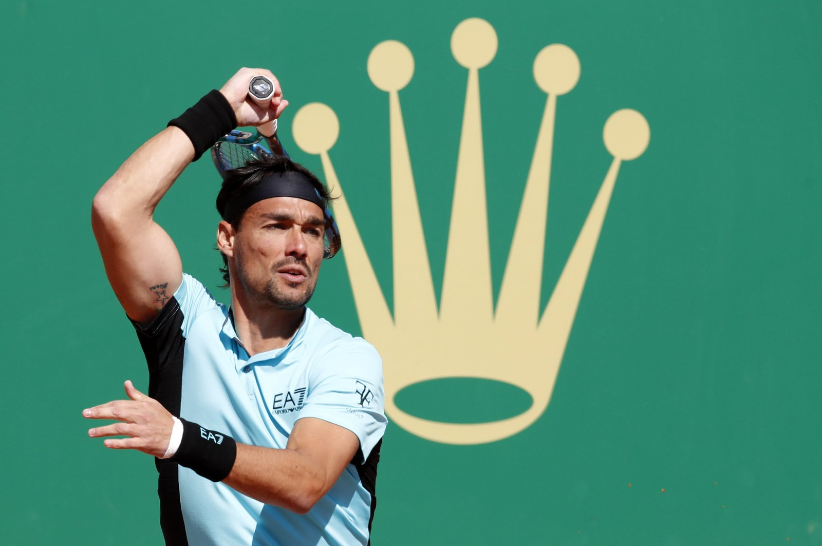 Italy's Fabio Fognini in action during his first-round match against Serbia's Miomir Kecmanovic at the Monte-Carlo Rolex Masters in Roquebrune Cap Martin, France, April 13, 2021. (EPA Photo)