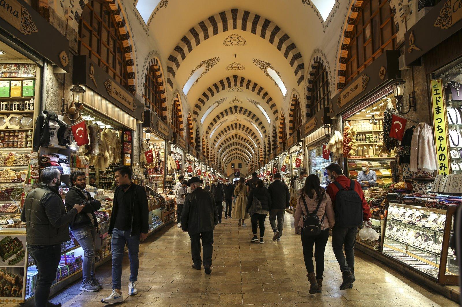 People walk inside historical Spice Bazaar, in Istanbul, Turkey, April 13, 2021. (AP Photo)