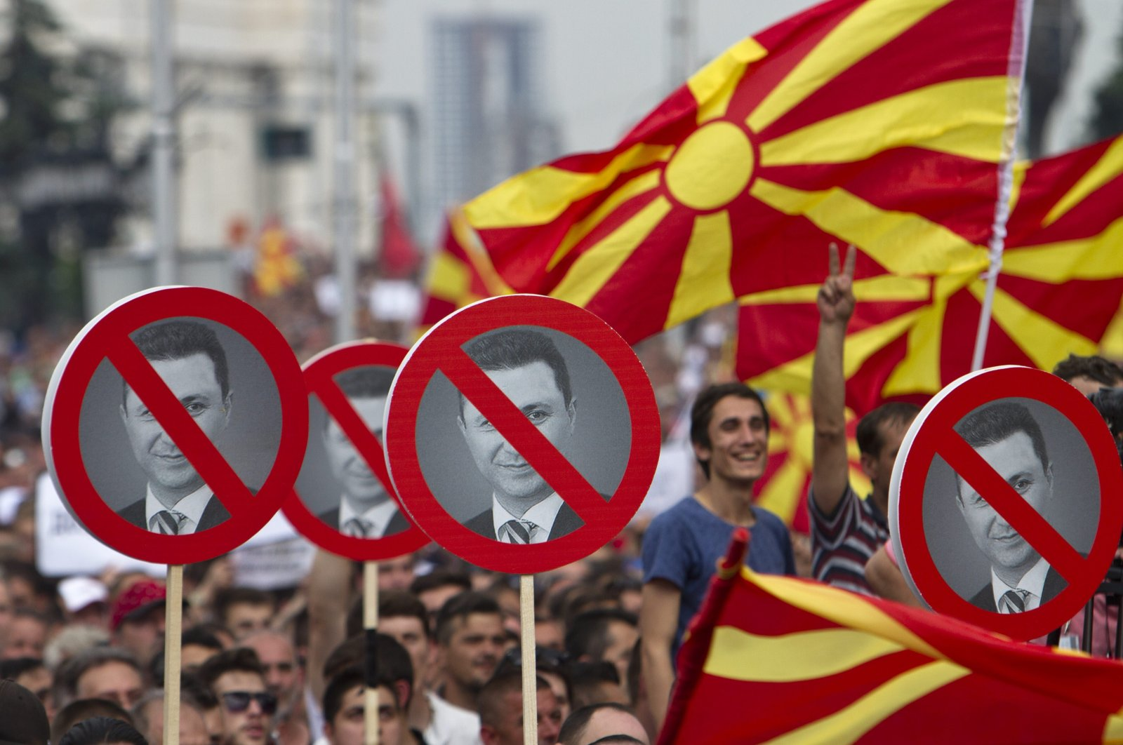 Macedonian protester hold signs with the picture of Macedonia's Prime Minister Nikola Gruevski during an opposition rally demanding his resignation amid a series of scandals alleging high-level corruption and murder cover-ups in capital Skopje, Macedonia, May 17, 2015.  (AP File Photo)
