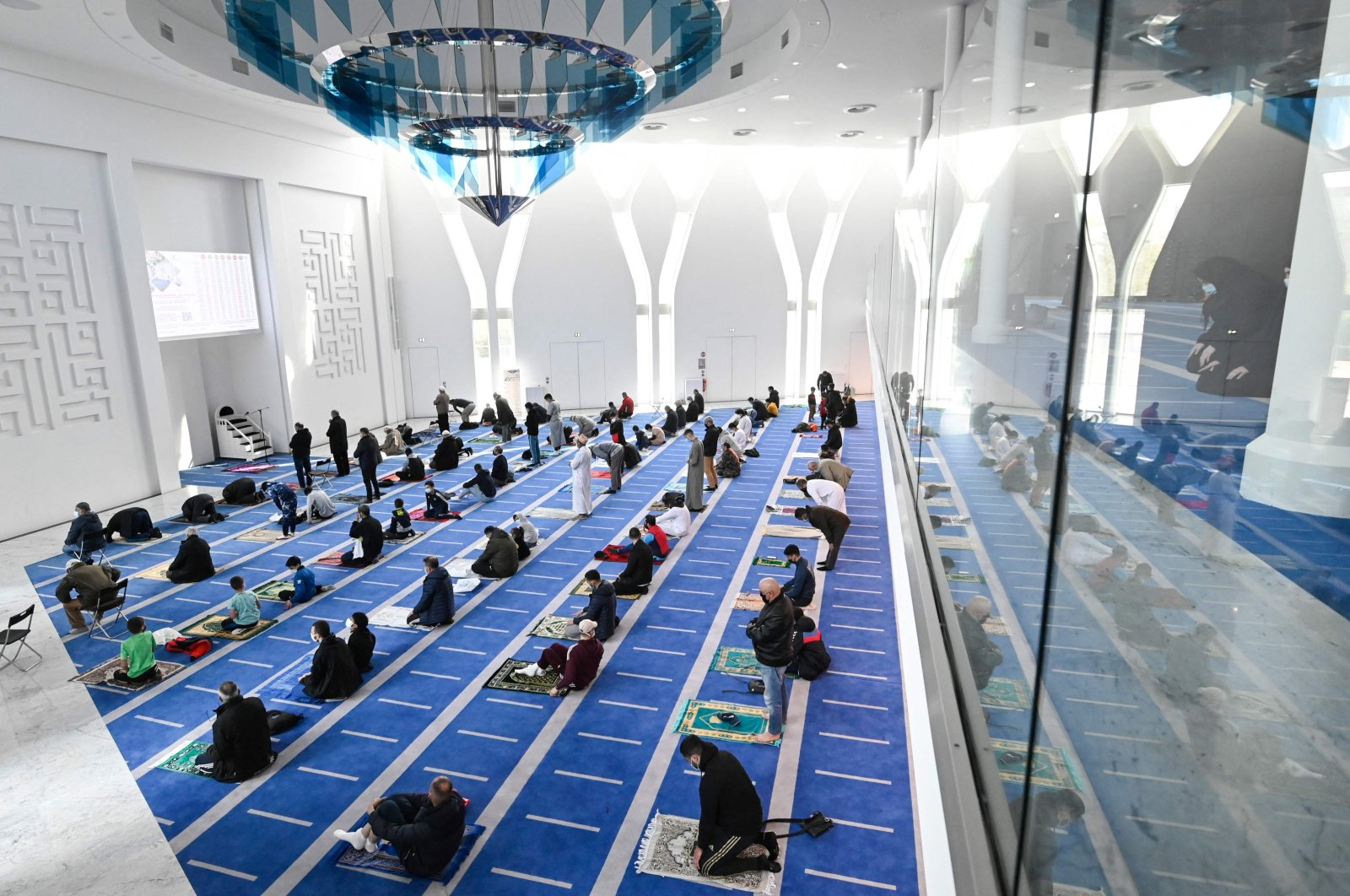 Muslim worshippers pray on the first day of the holy month of Ramadan at the al-Nour mosque in Mulhouse, eastern France, April 13, 2021. (AFP Photo)