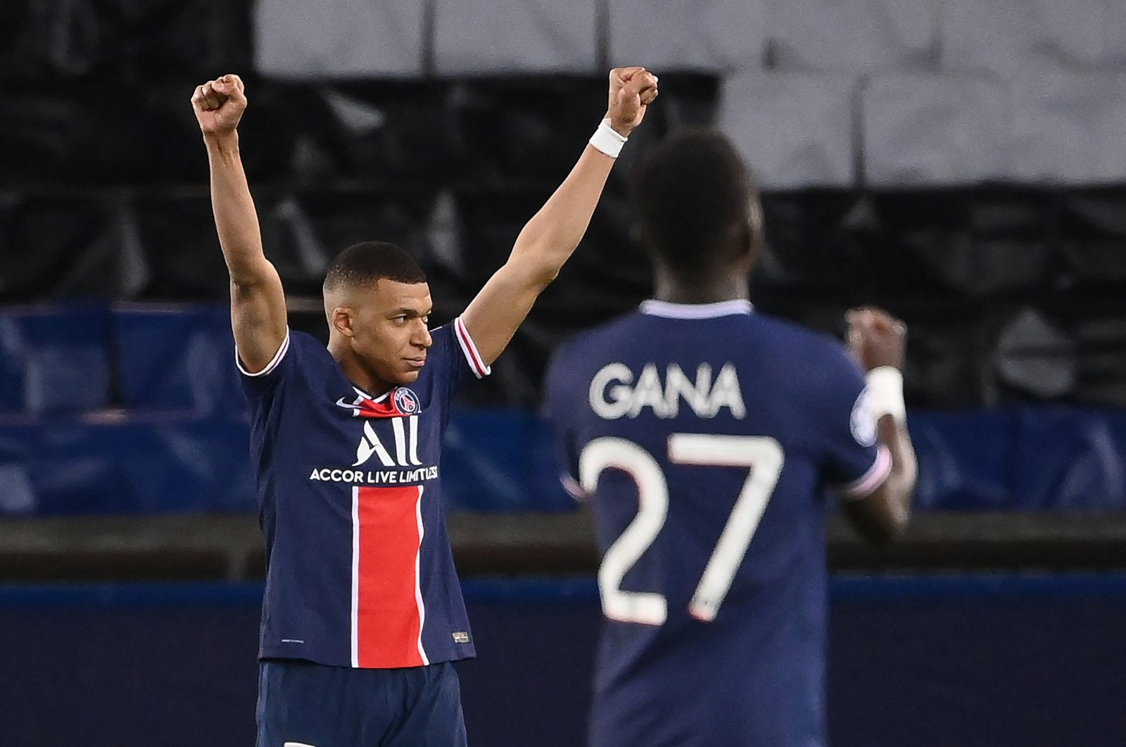 PSG's French forward Kylian Mbappe (L) and Senegalese midfielder Idrissa Gueye celebrate after winning the UEFA Champions League quarterfinal second leg football match against Bayern Munich at the Parc des Princes stadium in Paris, France, April 13, 2021. (AFP Photo)