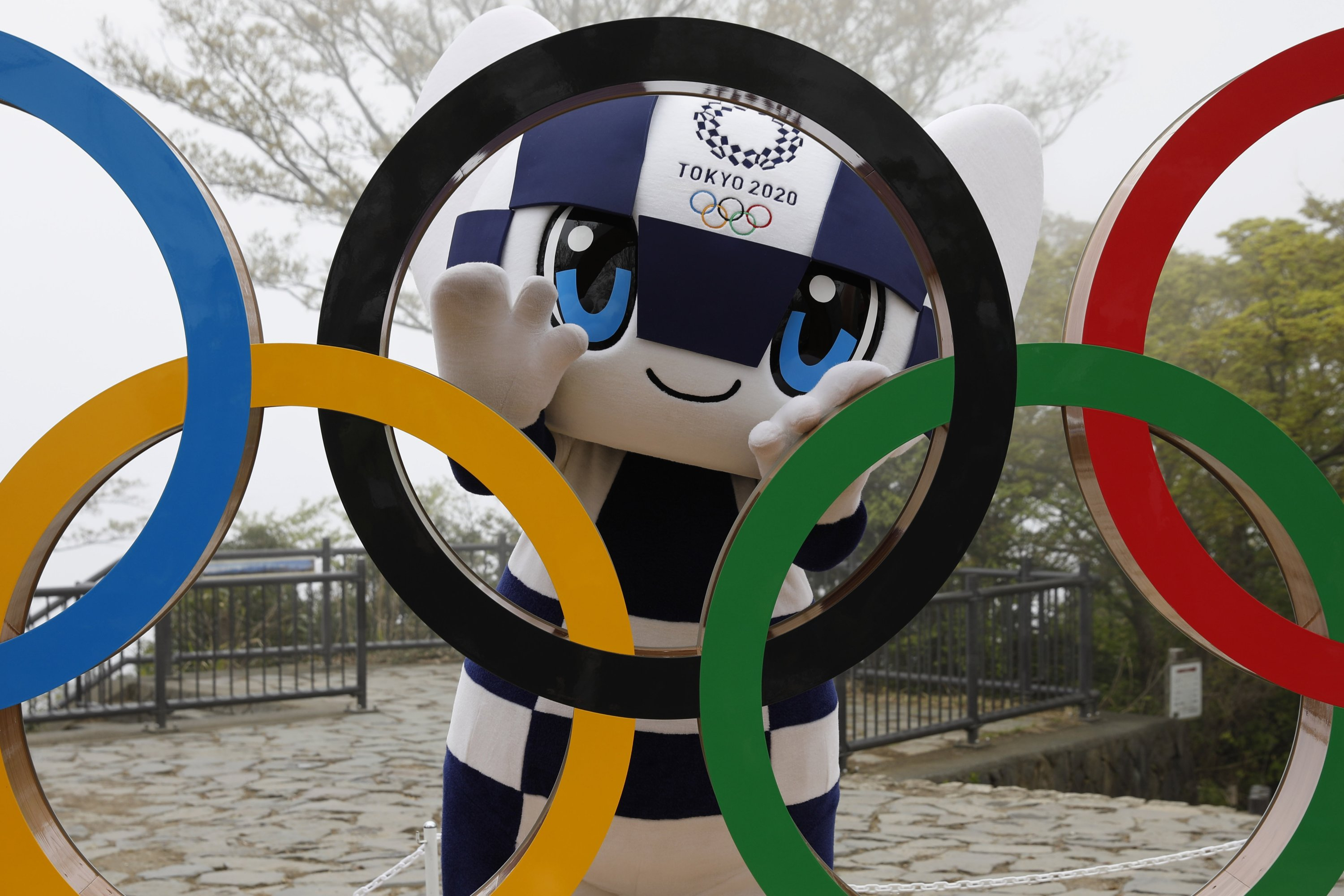 Tokyo 2020 Olympic Games mascot Miraitowa poses with a display of Olympic Symbol after an unveiling ceremony of the symbol on Mt. Takao in Hachioji, west of Tokyo, April 14, 2021, to mark 100 days before the start of the Olympic Games. (AP Photo)