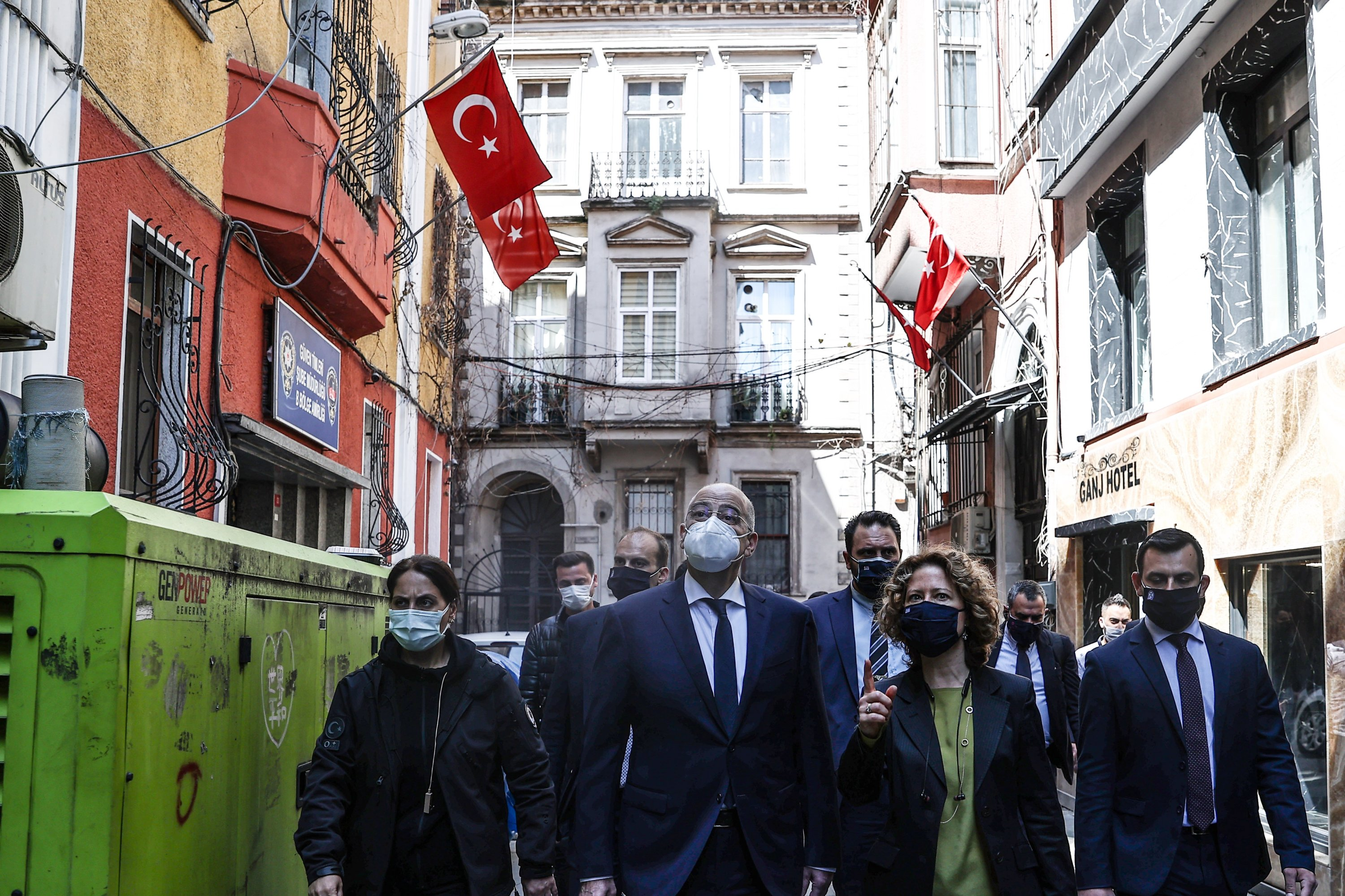 Greek Foreign Minister Nikos Dendias is having a short walk to visit a private Greek school in Taksim district of Istanbul, Turkey, April 14, 2021. (AA)