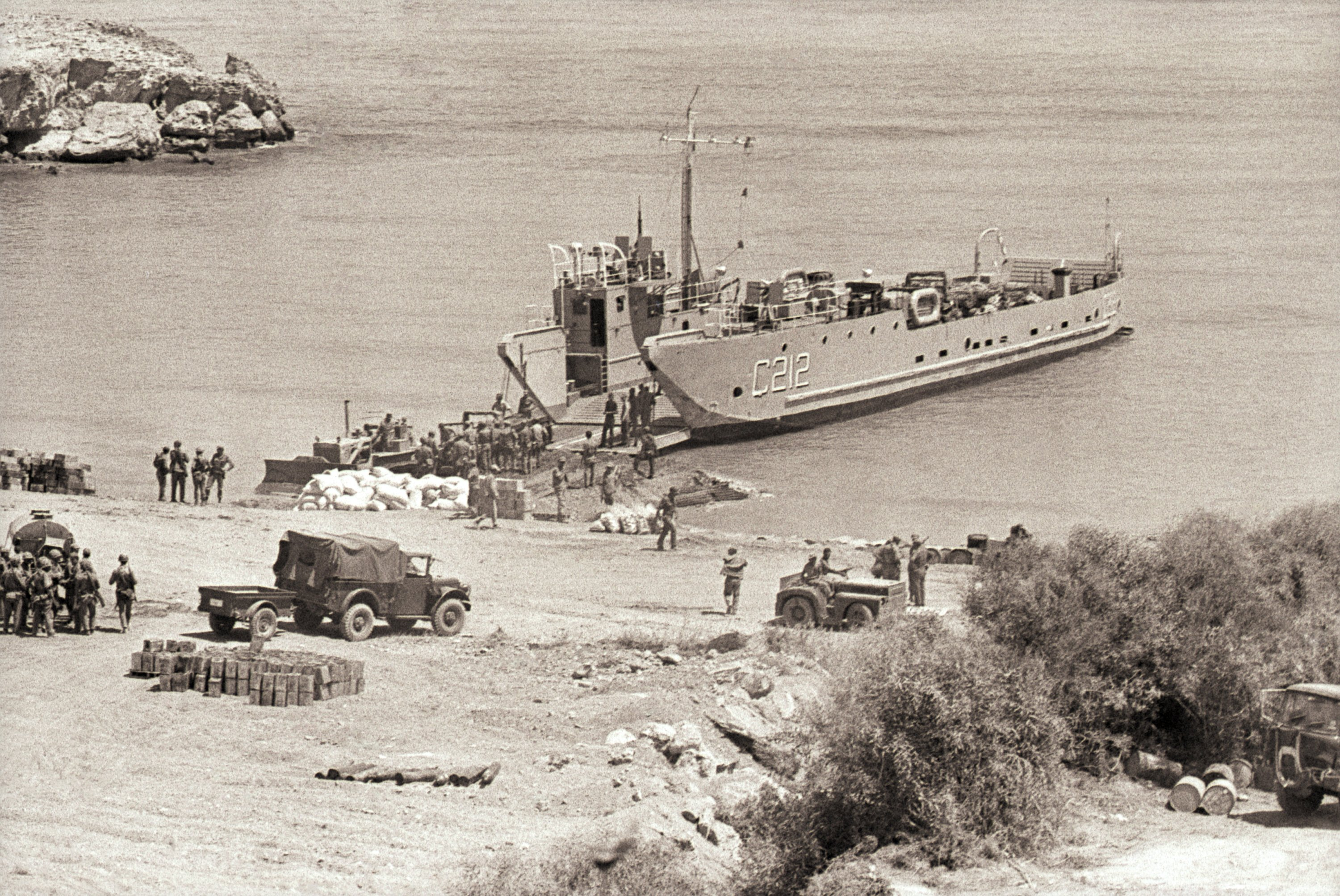 A Turkish navy landing craft unloads men and supplies for Turkey's 2nd army at a beachhead near Kyrenia, Cyprus (in what is now the Turkish Republic of Northern Cyprus), July 30, 1974. (Photo by Getty Images)
