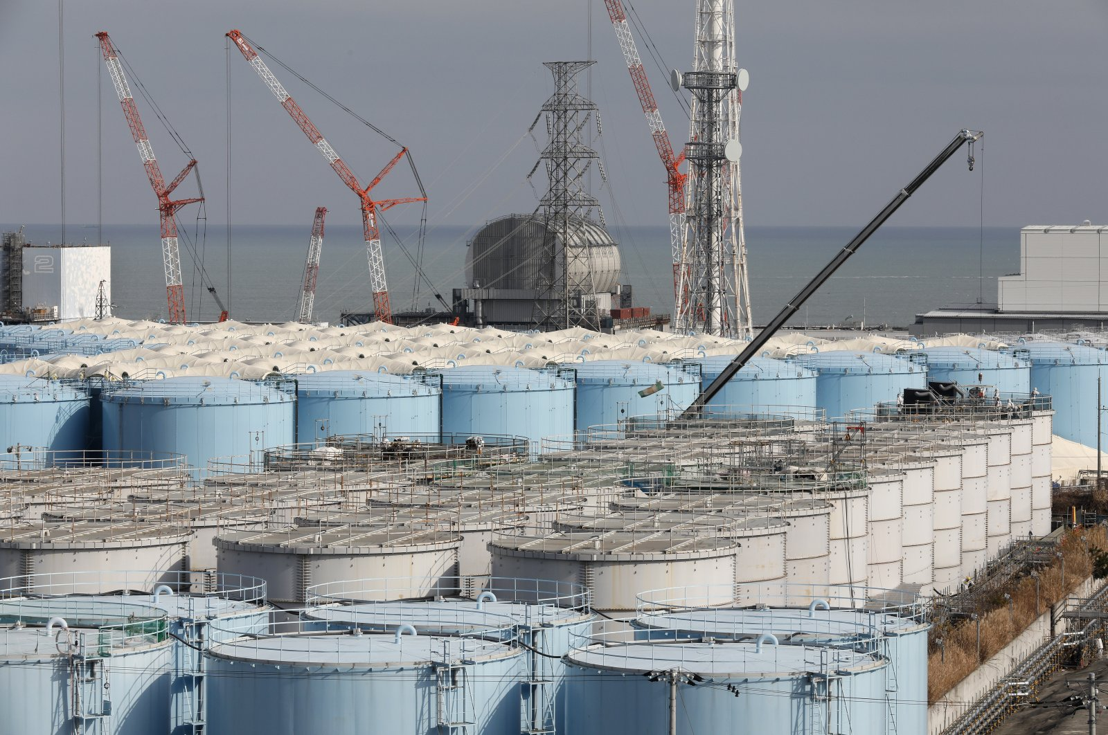 Workers demolish old storage tanks including water processed in ALPS (Multi-nuclide retrieval equipment) at the tsunami-devastated Tokyo Electric Power Company (TEPCO) Fukushima Daiichi Nuclear Power Plant in Okuma town, Fukushima Prefecture, Japan, Jan. 22, 2020. (EPA Photo)