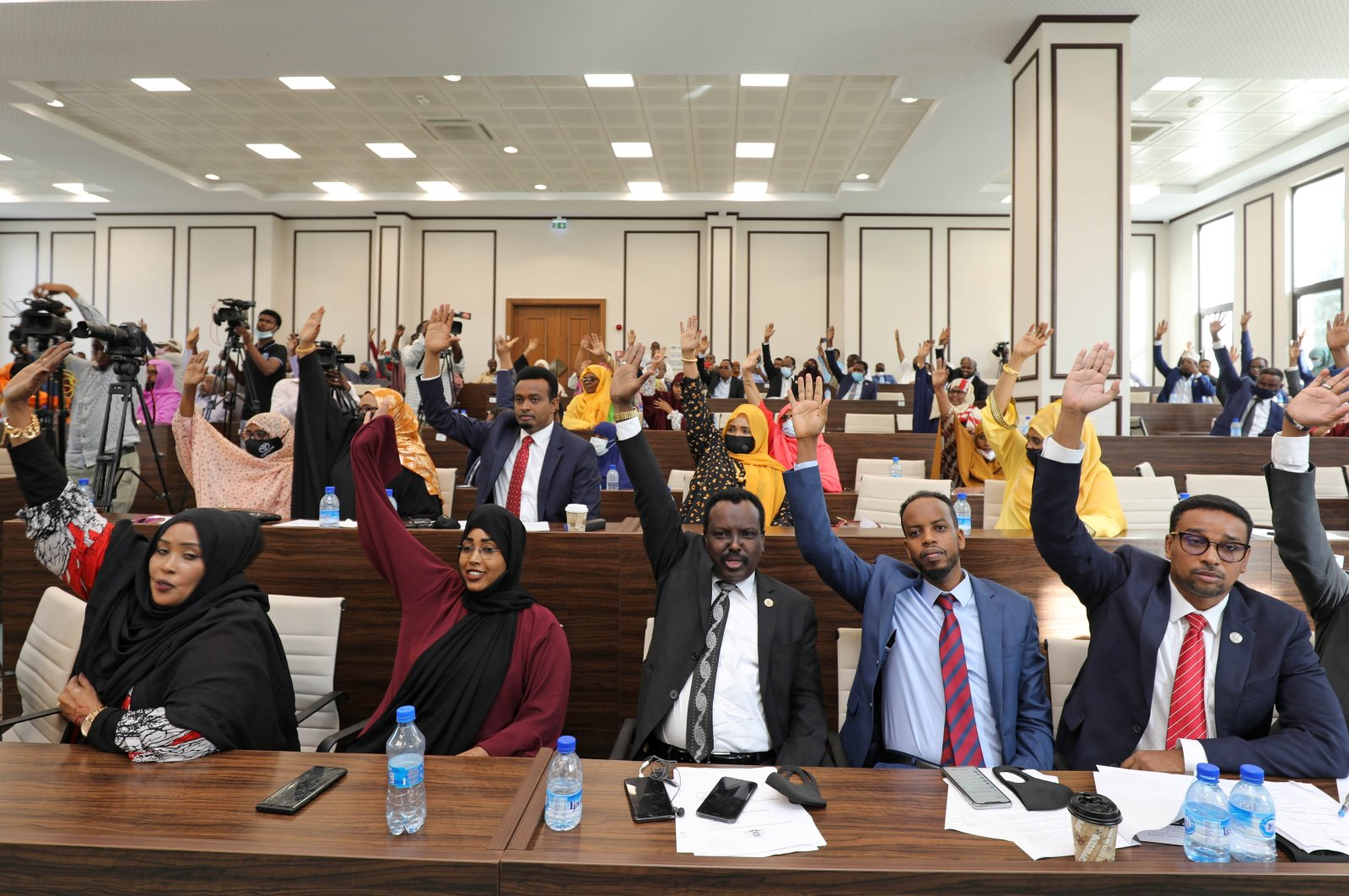 Somali legislators of the lower house of parliament raise their hands to vote to extend President Mohamed Abdullahi Mohamed's term for another two years to let the country prepare for direct elections, in Mogadishu, Somalia, April 12, 2021. (Reuters Photo)
