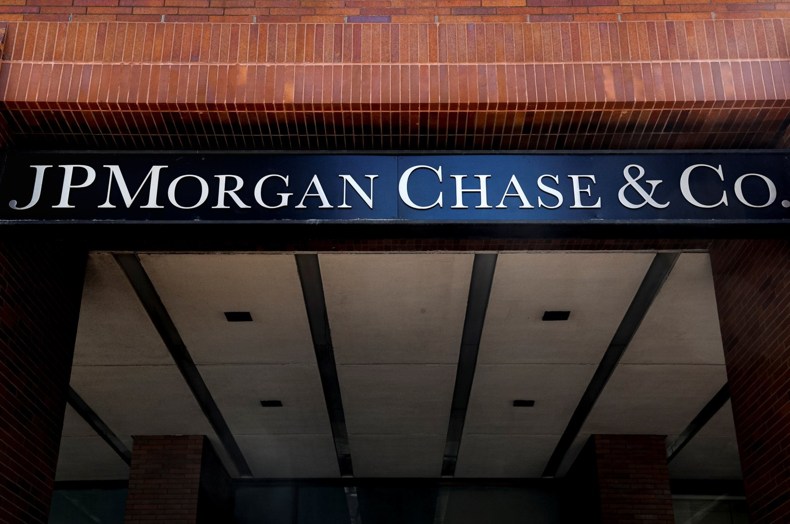 A sign outside JP Morgan Chase & Co. offices is seen in New York City, U.S., March 29, 2021.  (Reuters Photo)