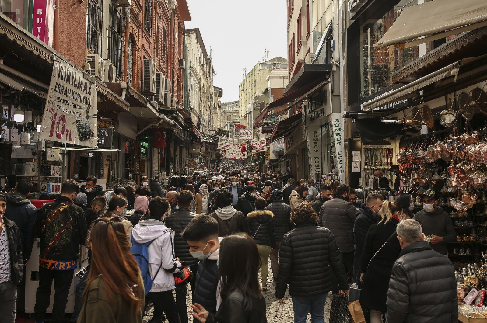 People walk in the Eminönü open market in Istanbul, Turkey, April 2, 2021. (AP Photo)