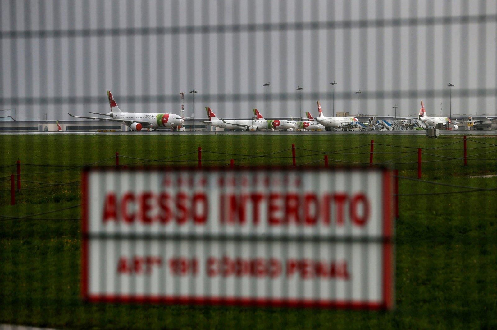 Planes are seen at the Humberto Delgado Airport in Lisbon, Portugal, Dec. 11, 2020. (Reuters Photo)