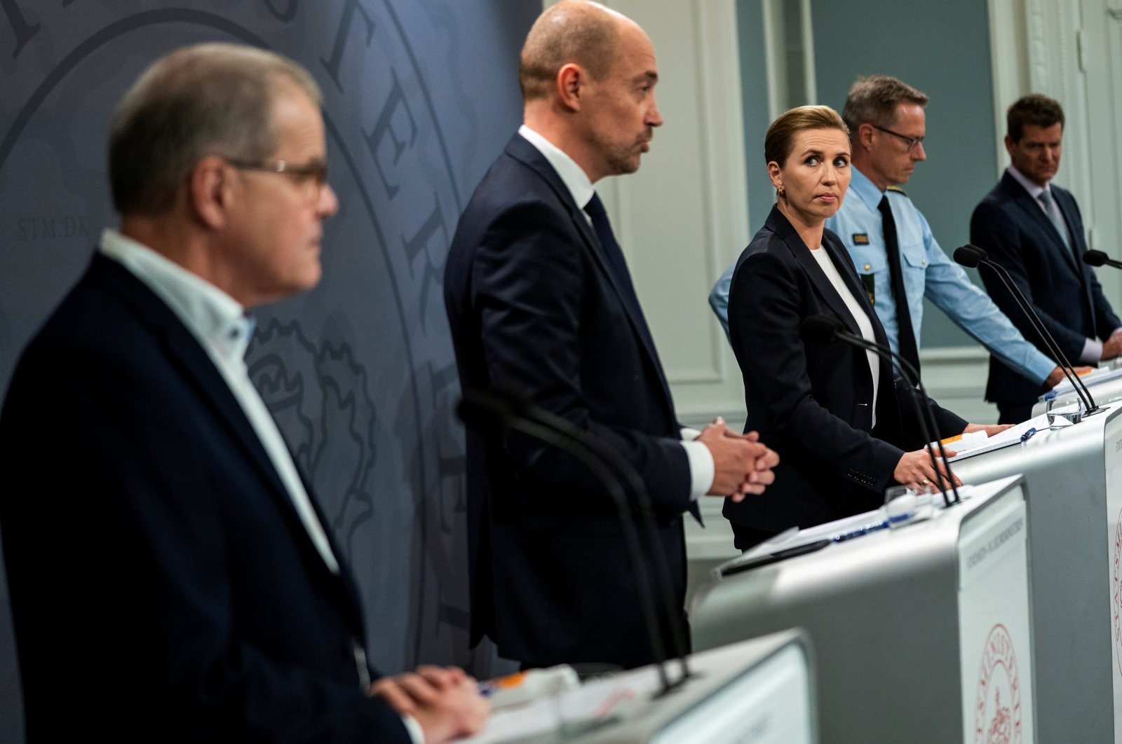 Denmark's Prime Minister Mette Frederiksen, Health Minister Magnus Heunicke (2-L), Kaare Moelbak of the Statens Serum Institut (L), Soren Brostrom director of the National Board of Health (R) and Thorkild Fogde chief of police, (2-R), attend a COVID-19 news conference in Copenhagen, Denmark, Sept. 18, 2020. (Reuters Photo)