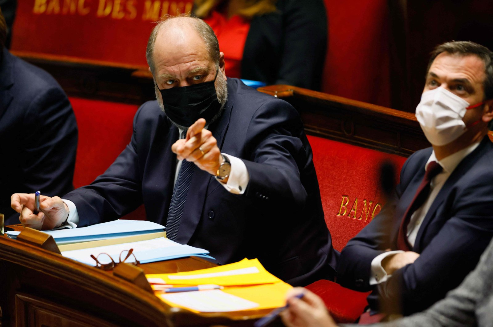 French Justice Minister Eric Dupond-Moretti (L) gestures next to French Health Minister Olivier Veran during a session of questions to the government at The National Assembly, Paris, March 23, 2021. (AFP Photo)