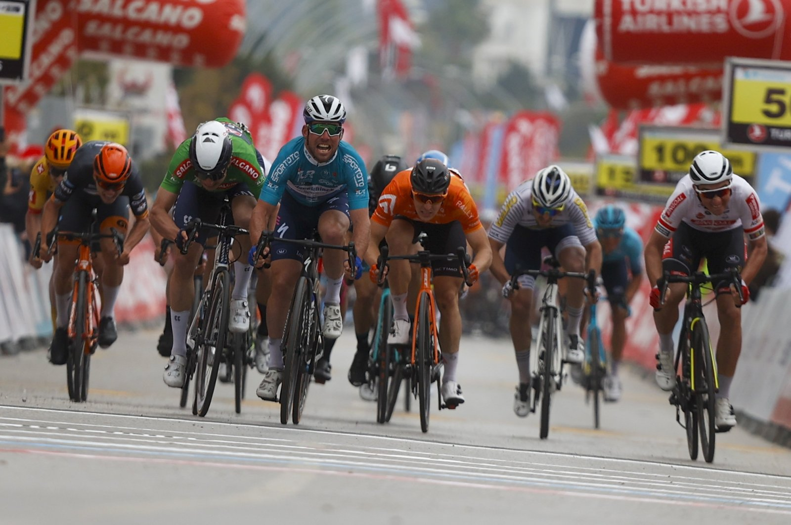Deceuninck-Quick Step's British sprinter Mark Cavendish leads the pack at the finish line of the 4th stage of the 56 Presidential Cycling Tour of Turkey, Kemer, southern Turkey, April 14, 2021. (AA Photo)