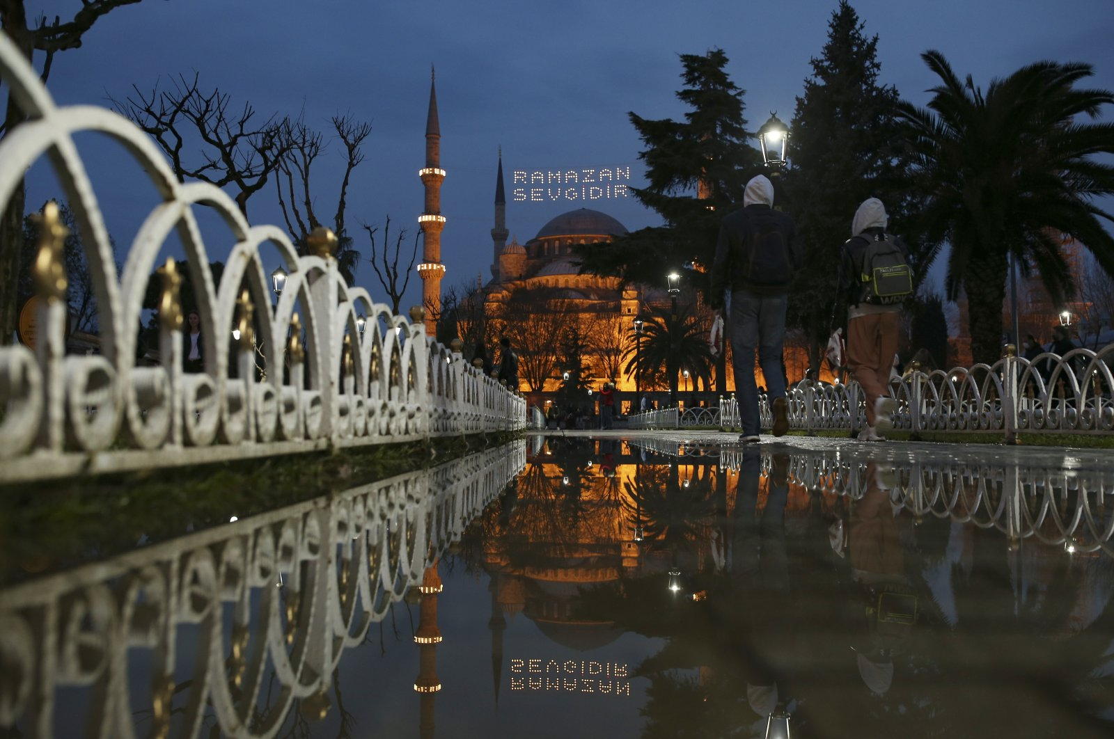 """The iconic Sultan Ahmet Mosque, better known as the Blue Mosque, decorated with lights and a slogan reading """"Ramadan is love,"""" in the historic Sultan Ahmet district of Istanbul, Turkey, Tuesday, April 13, 2021. (AP Photo)"""